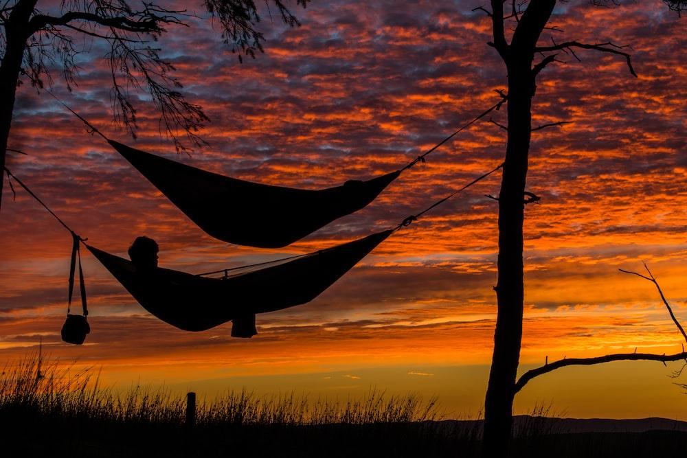 person lying on hammock