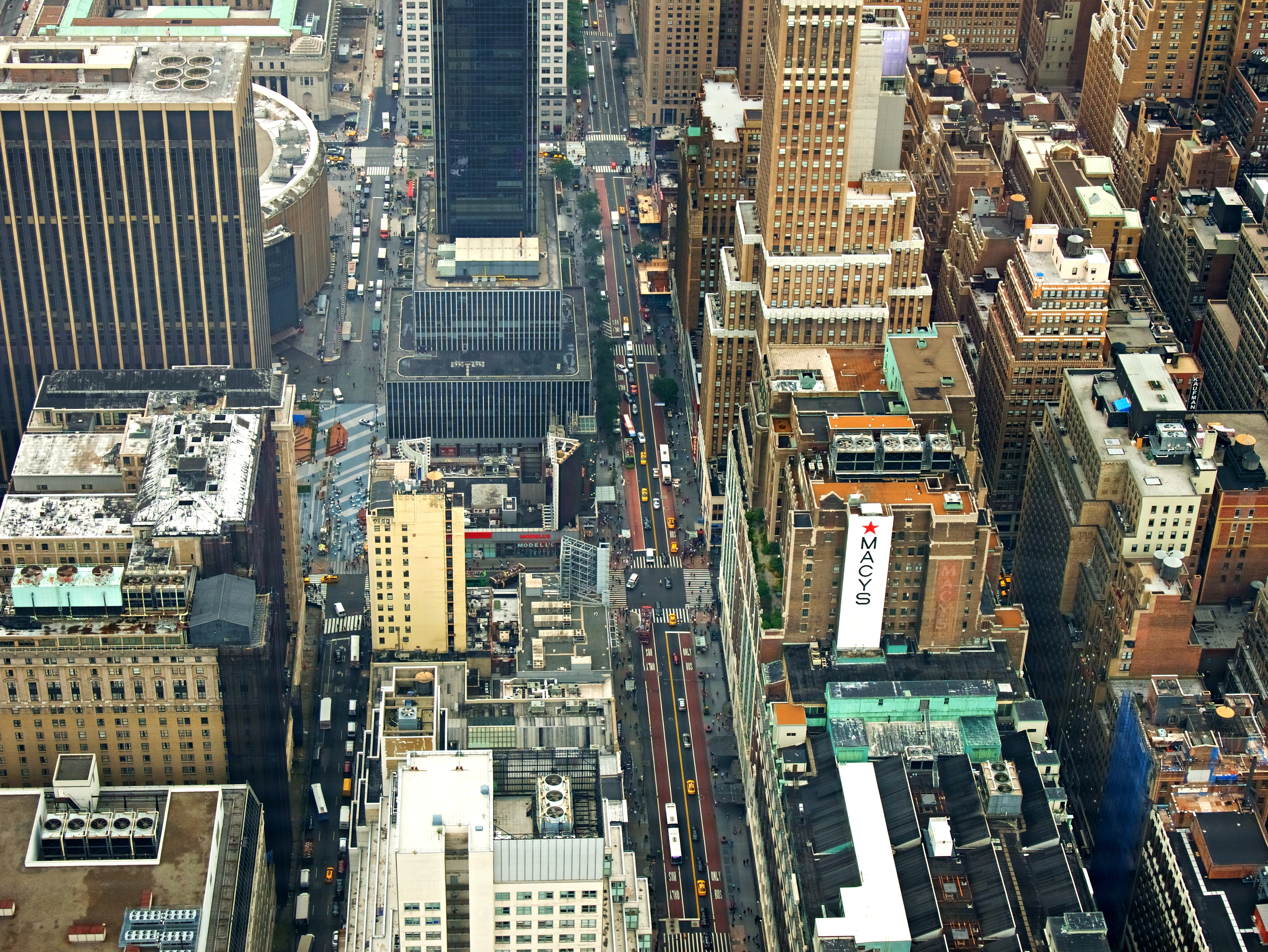 Drone view of the rooftops of buildings and the busy New York City streets