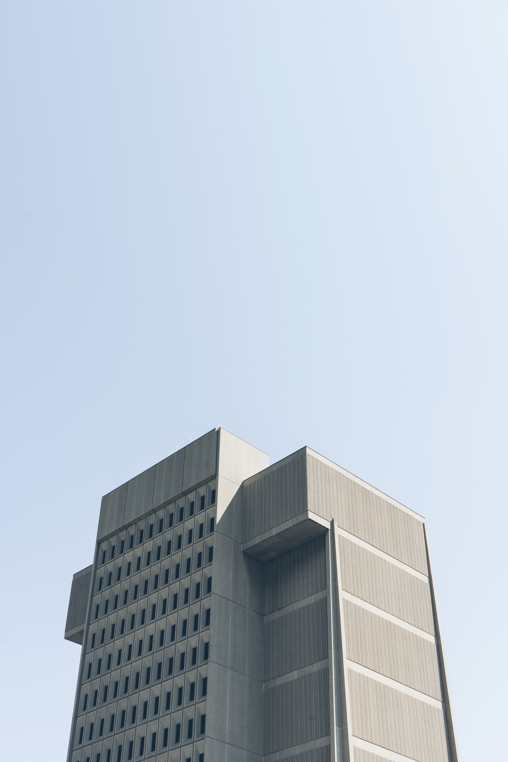low angle photography of grey building
