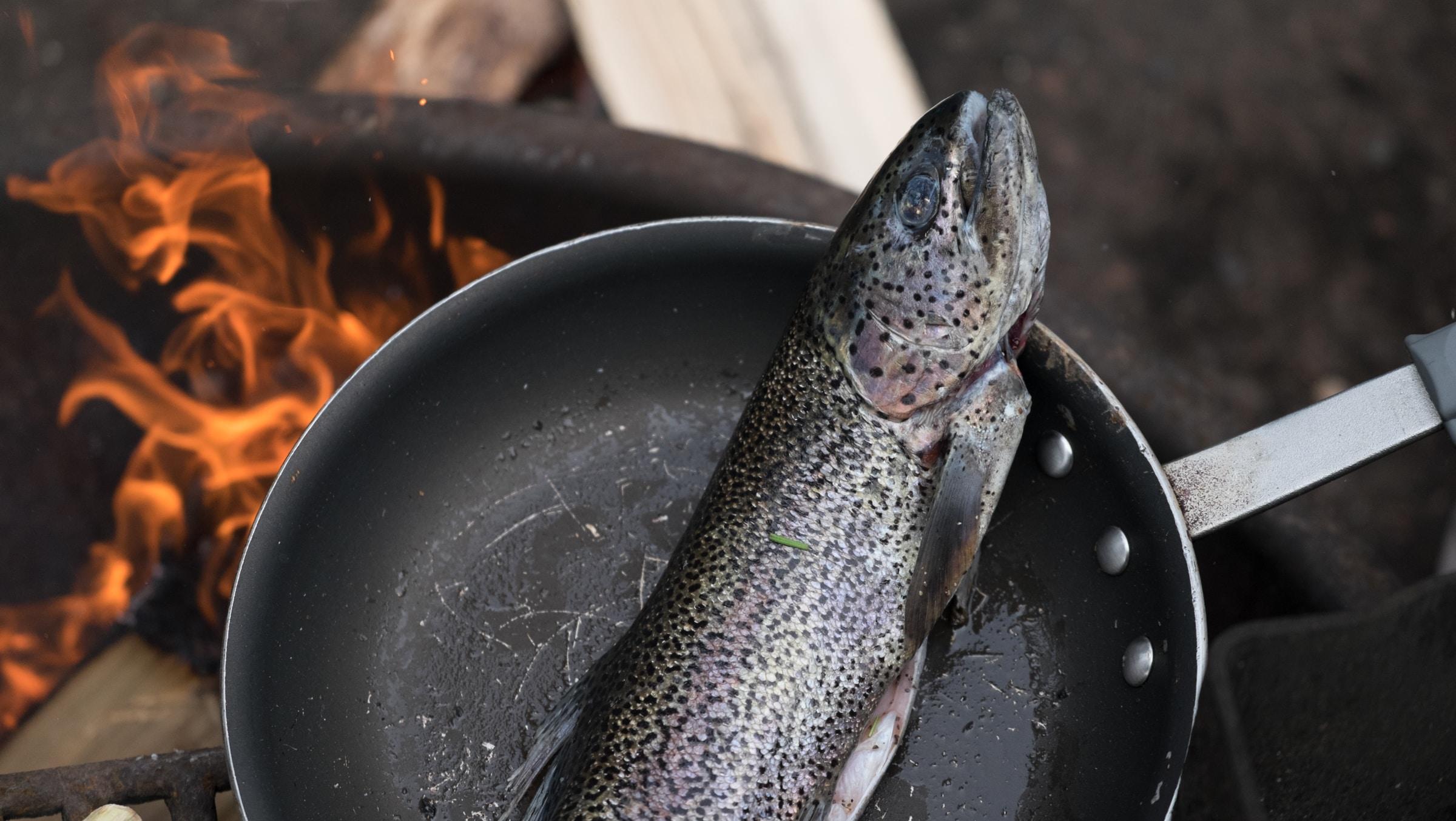 fish on black frying pan