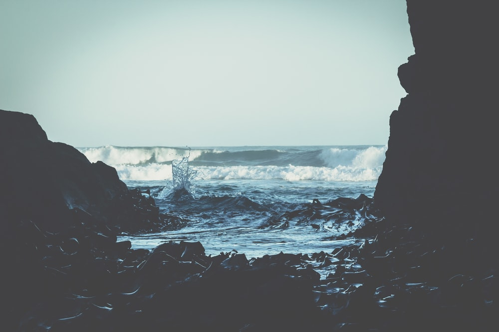 landscape photography of seashore and cave
