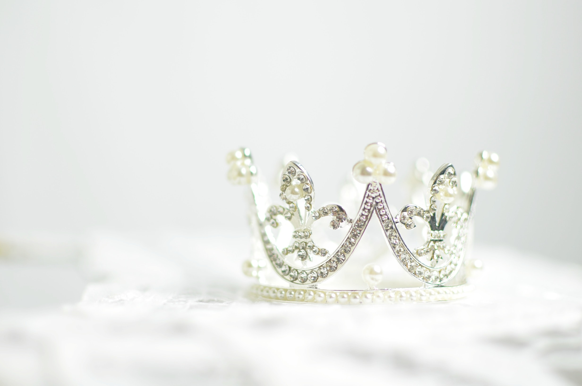 shallow photography of silver-colored crown