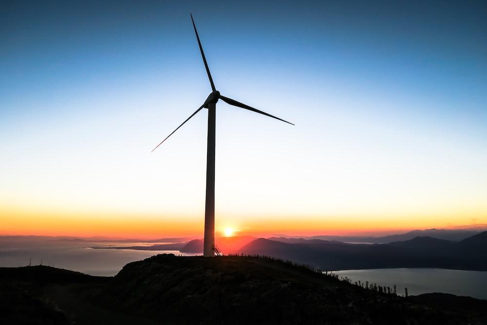 silhouette of wind mill during golden hour sustainable procurement Winnipeg Metropolitan Region