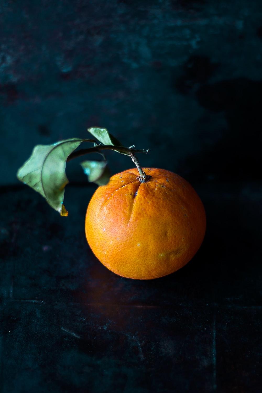 orange fruit on black panel
