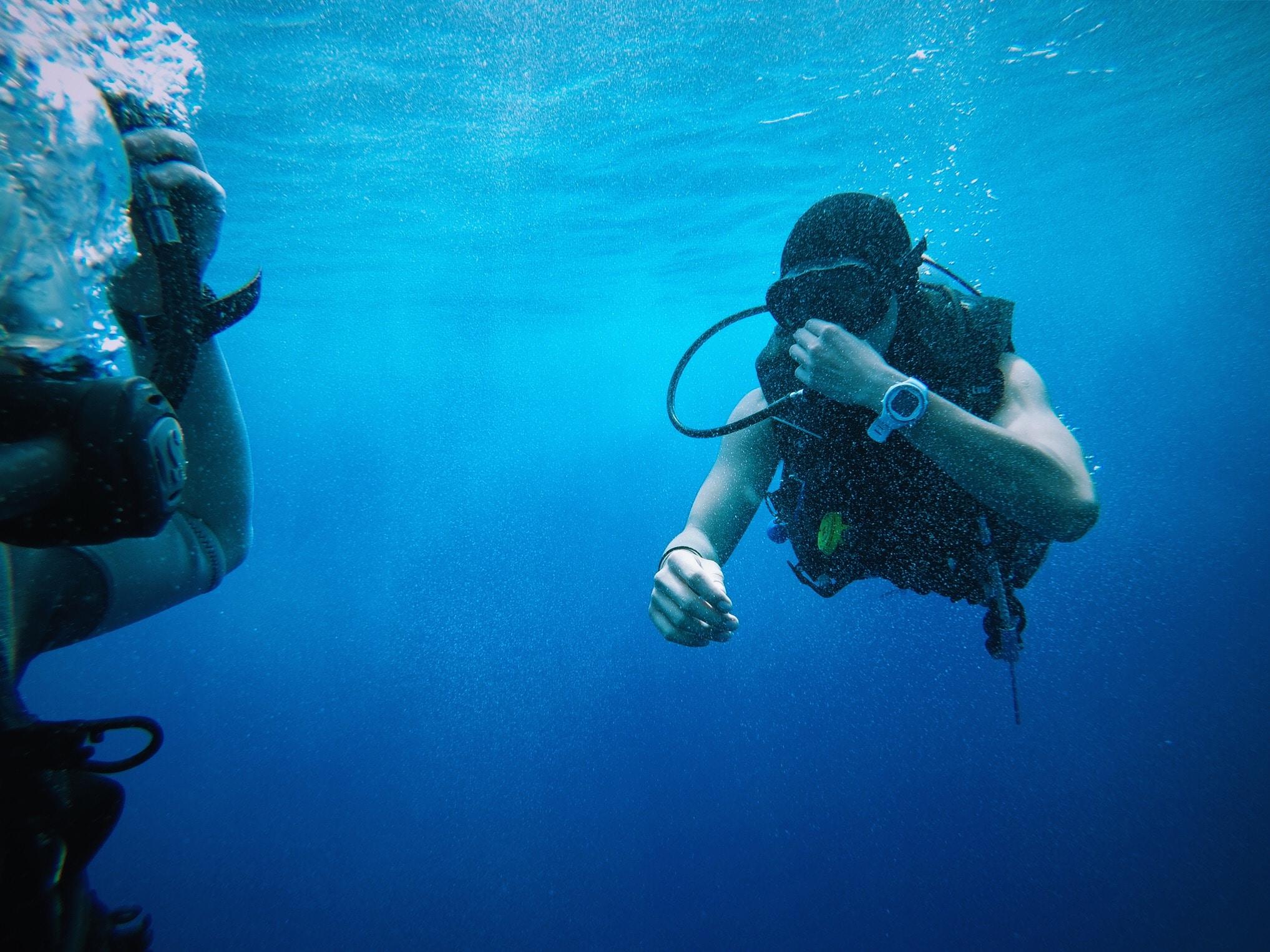 person scuba underwater