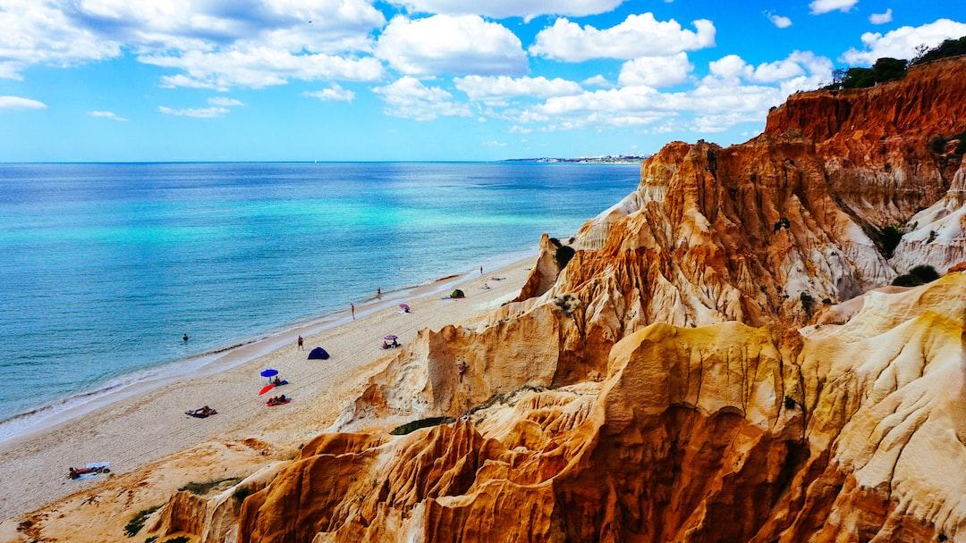 Rock cliffs on sand coastline