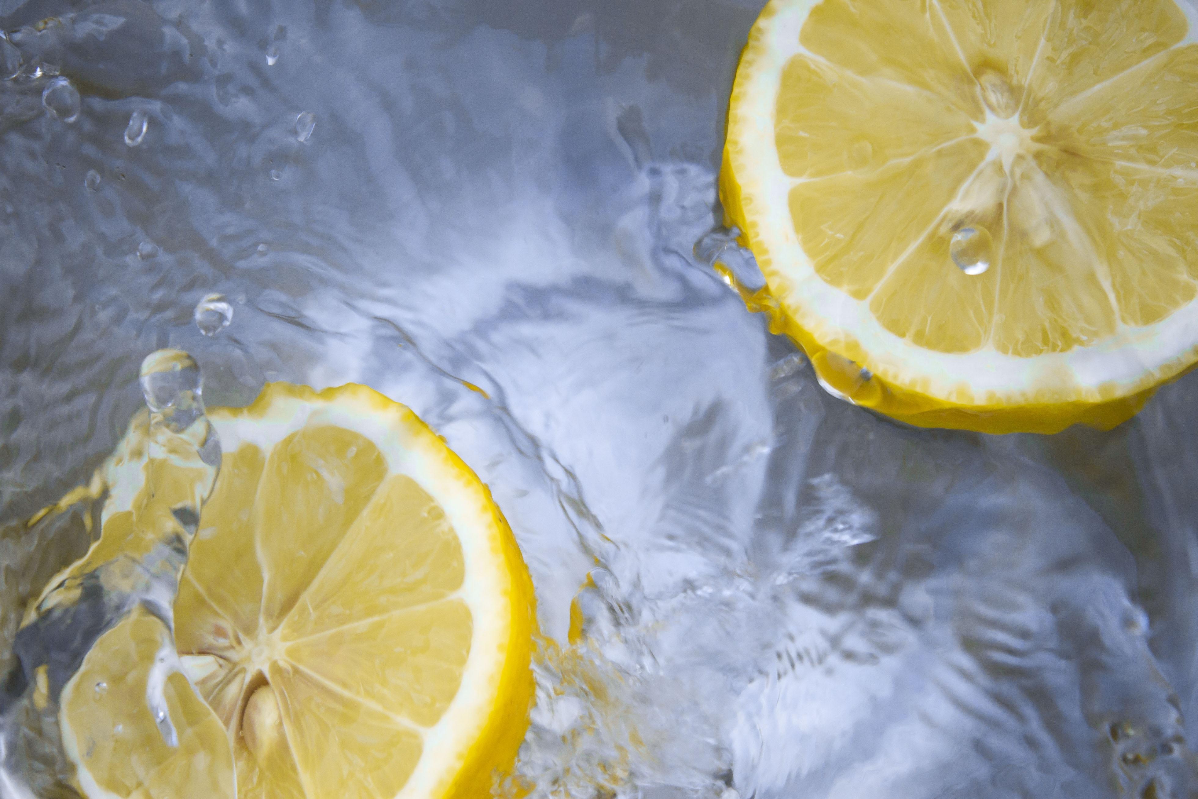 Lemons floating in water