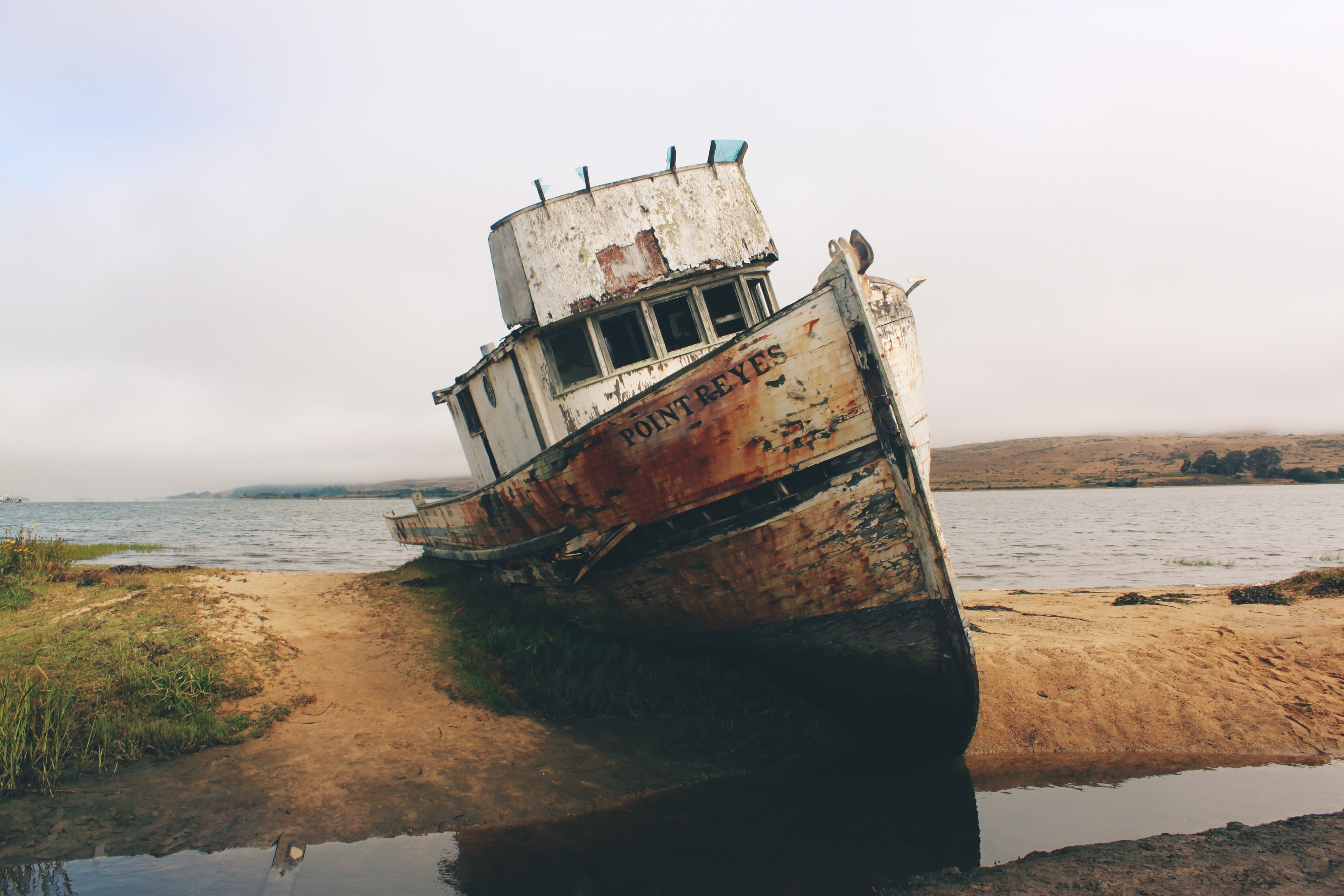 An abandoned old wrecked ship on the shore of the ocean at point Reyes station.