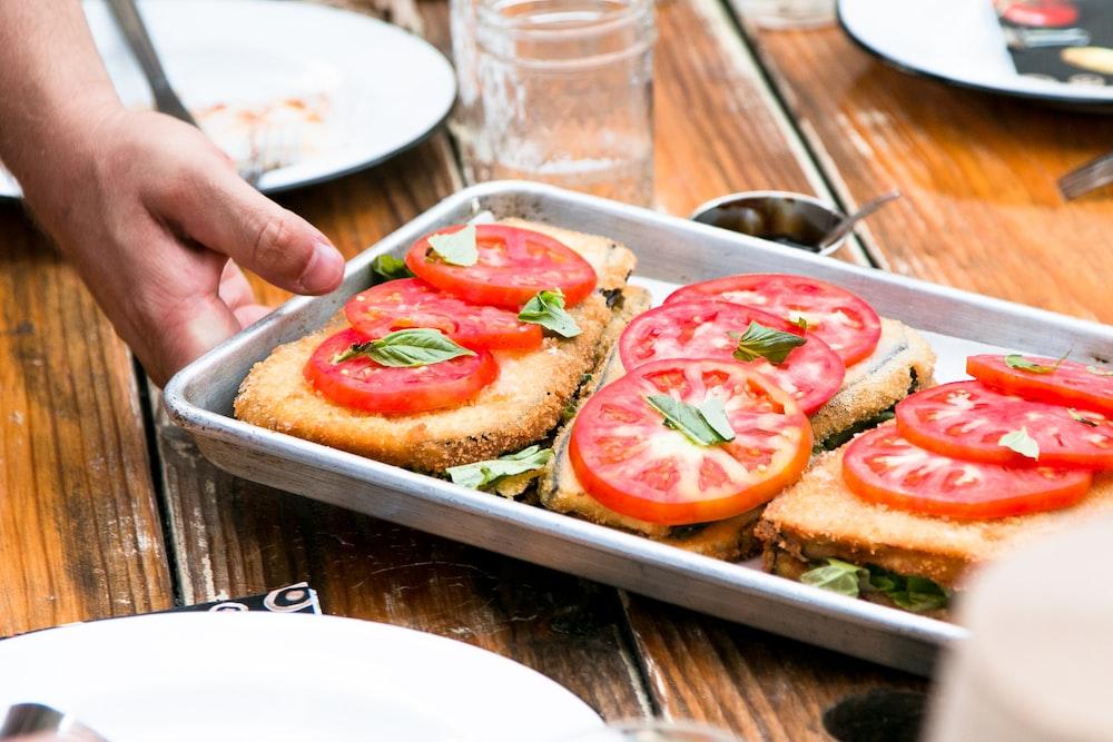 deef fried vegetables being served on a gray steel pan