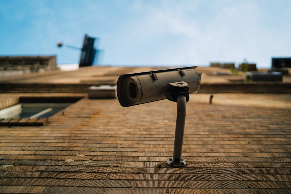 shallow focus photography of gray security camera
