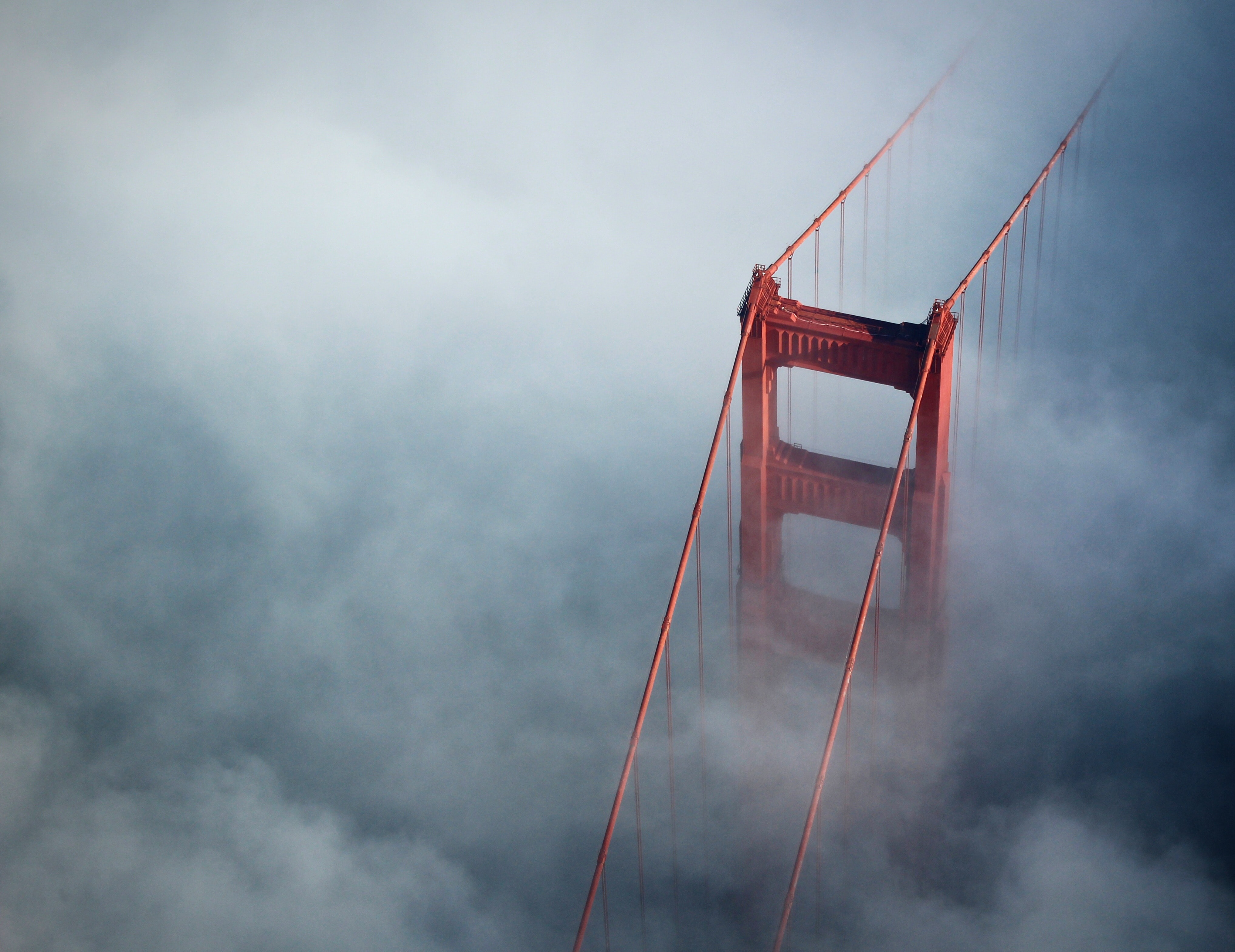 Aerial view of Golden Gate Bridge on a foggy day