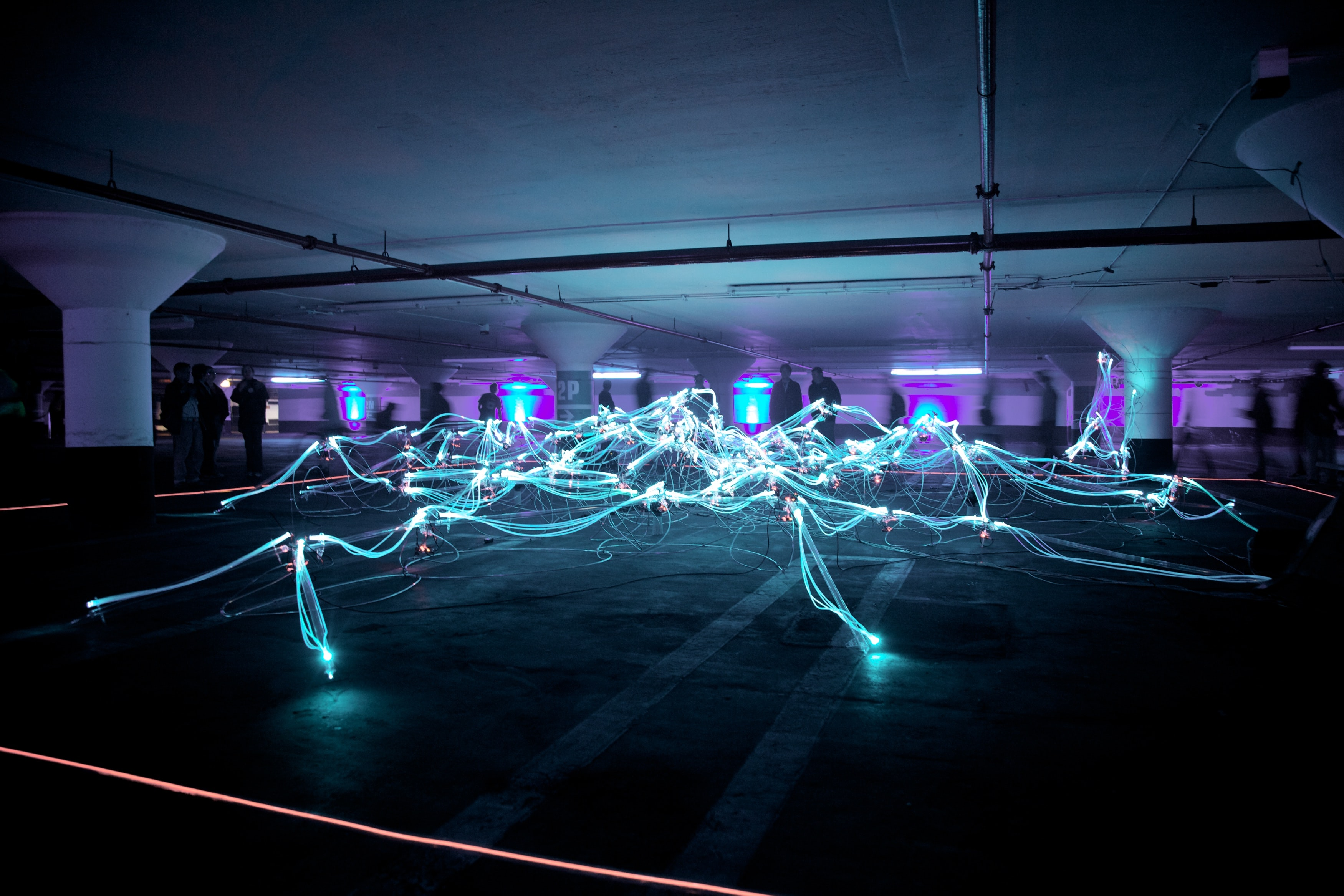 linked neon lights under white painted basement