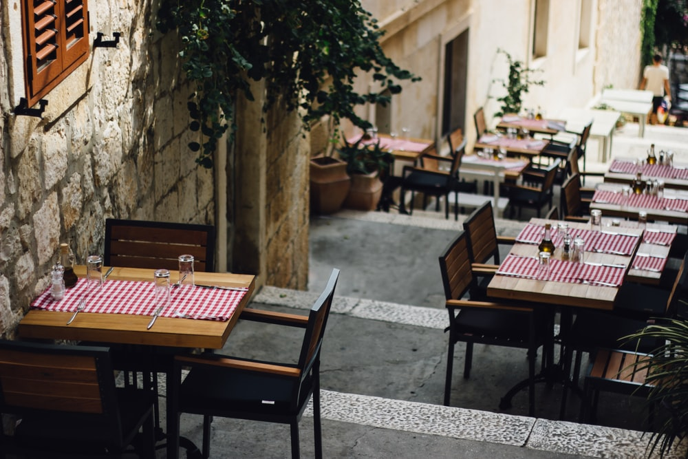 tables and chairs outside the building