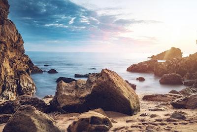 huge rock near beach seaside zoom background