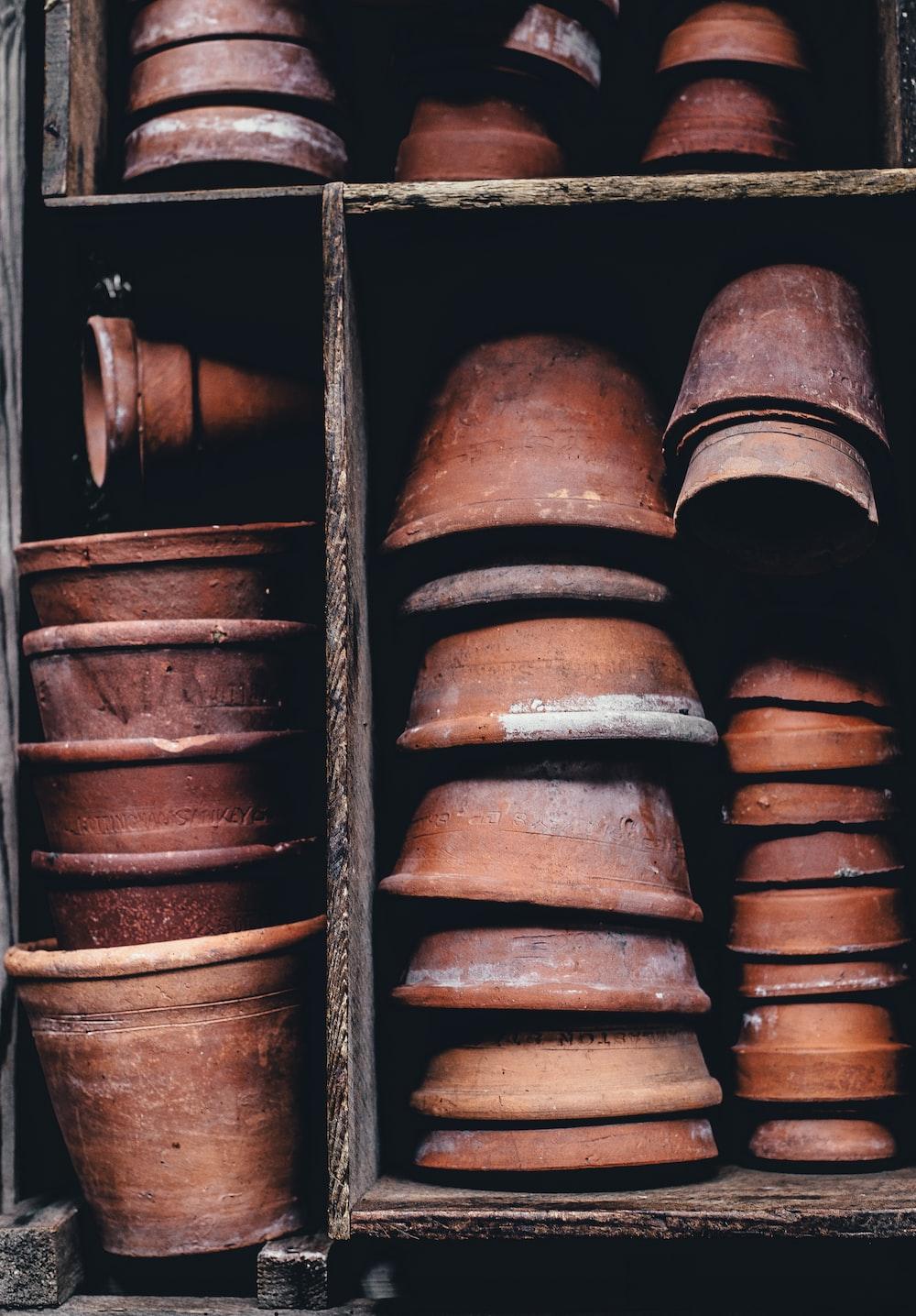 closeup photo of stack of brown clay pot lot