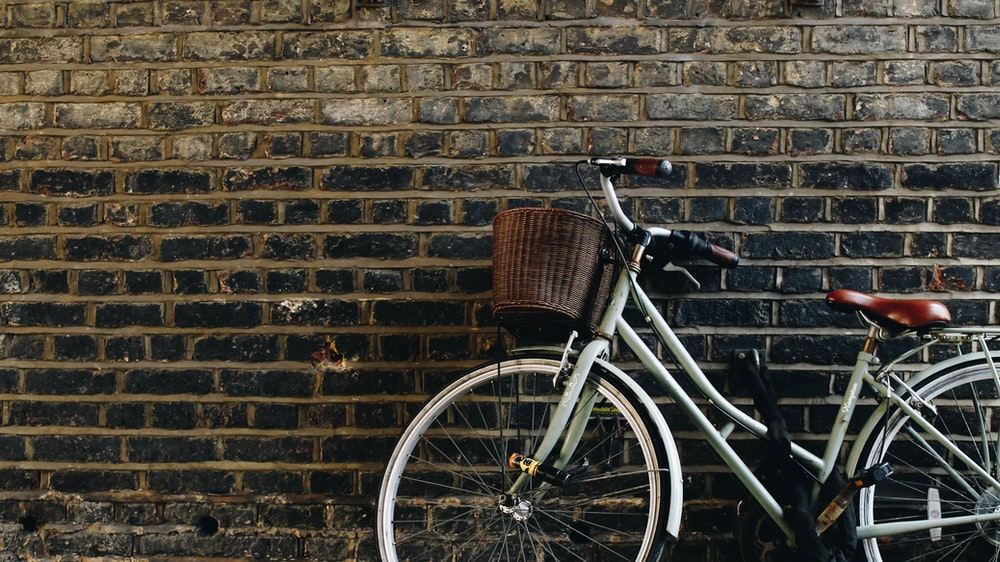 step-through bike leaning on wall