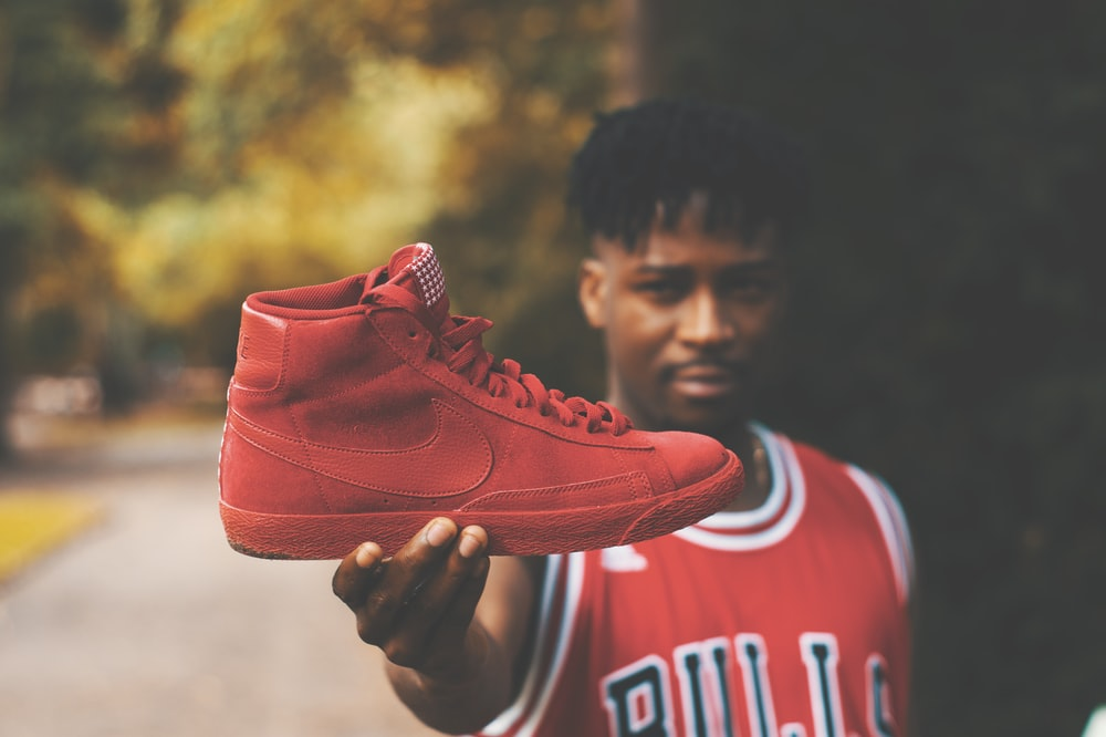man showing red Nike high-top sneaker