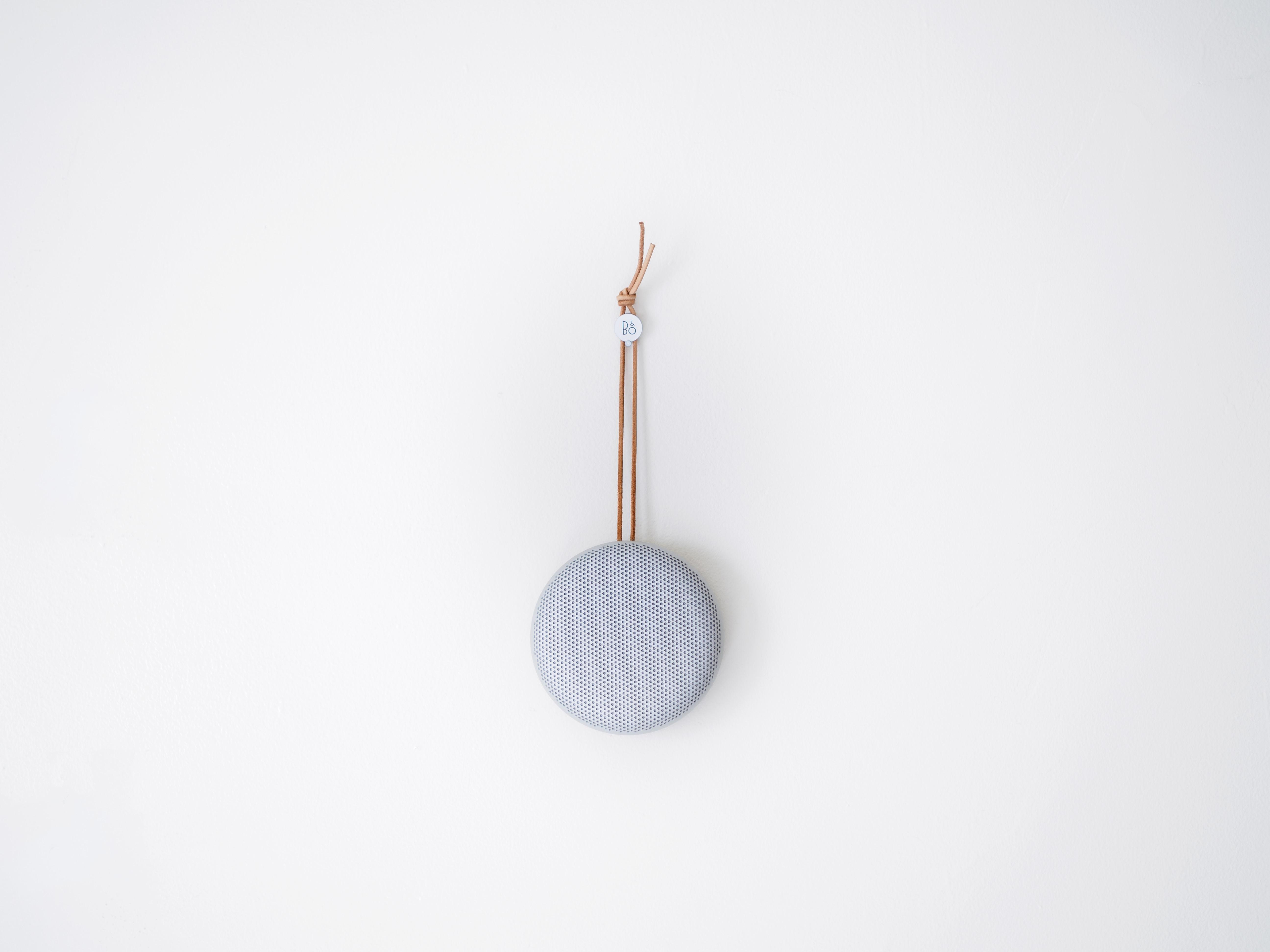 round grey hanging decor on white wall