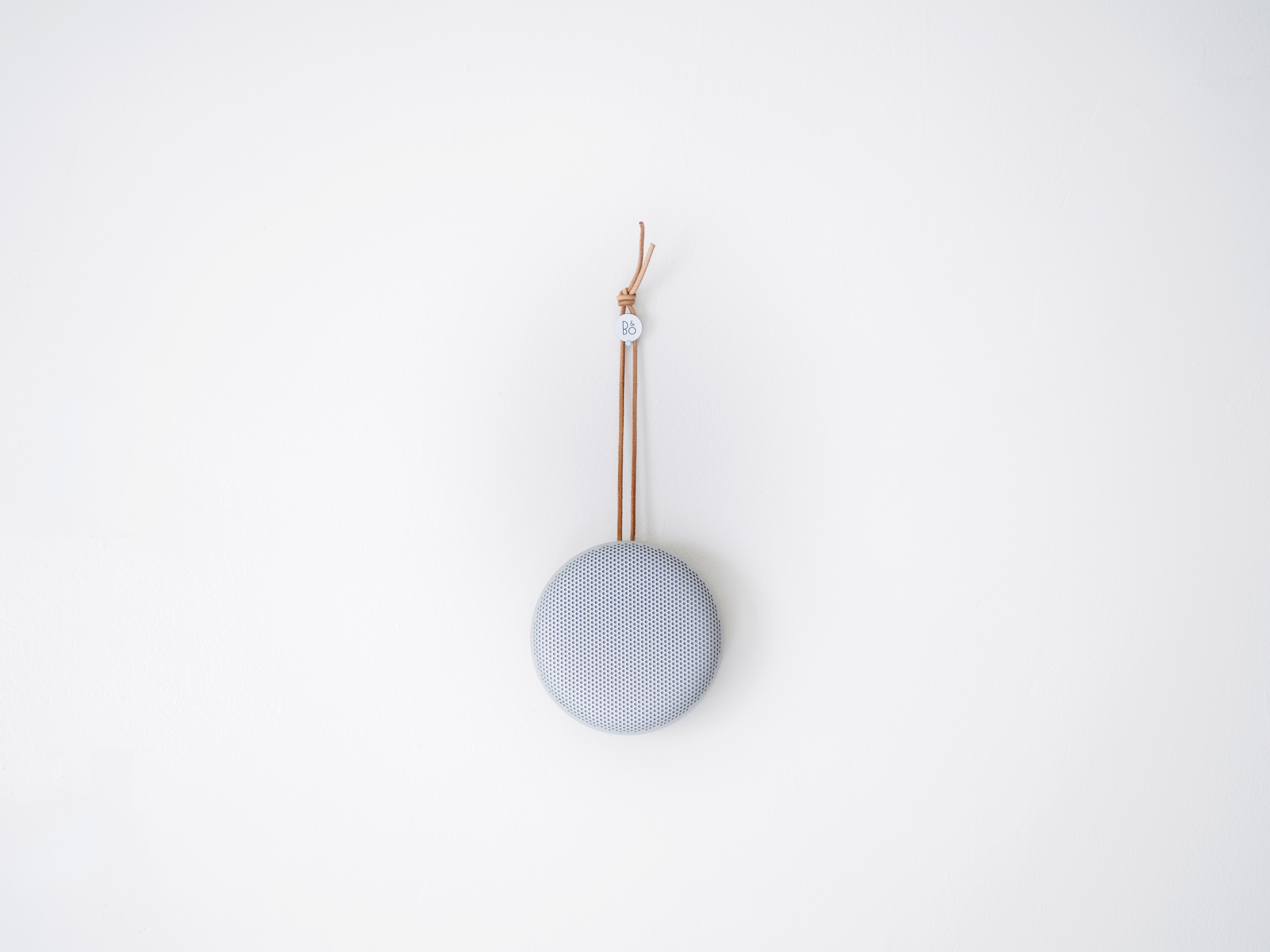 round grey hanging decor on white wall