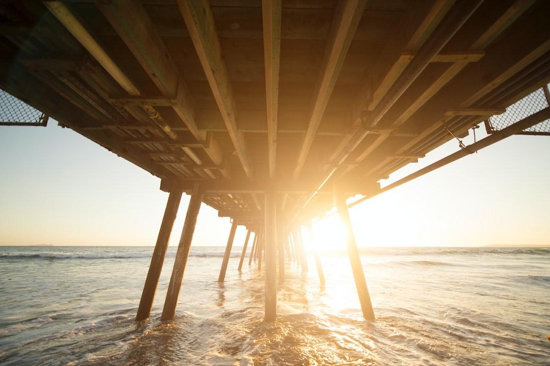 Sunrise below pier