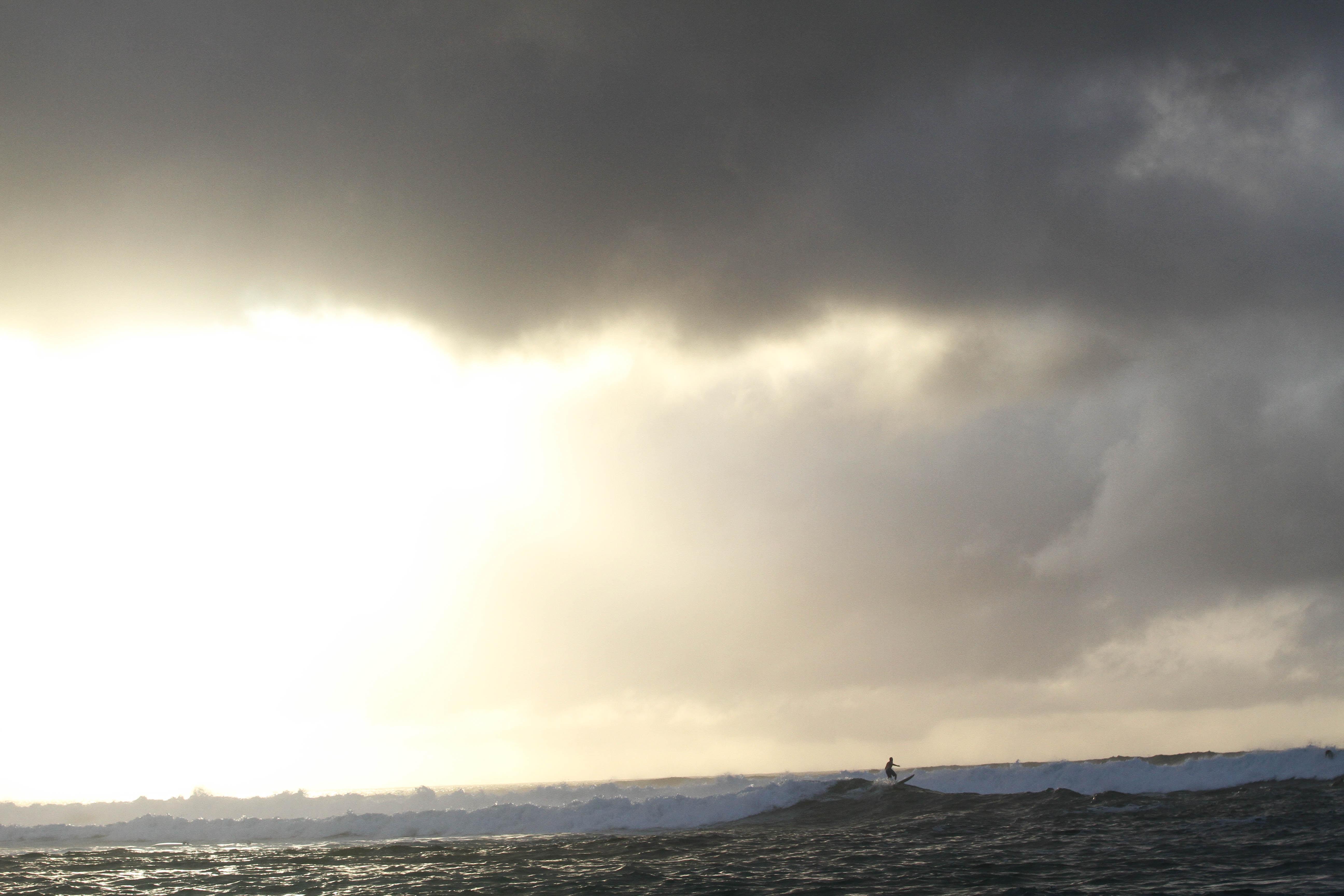 Sunrise coming through dark clouds.