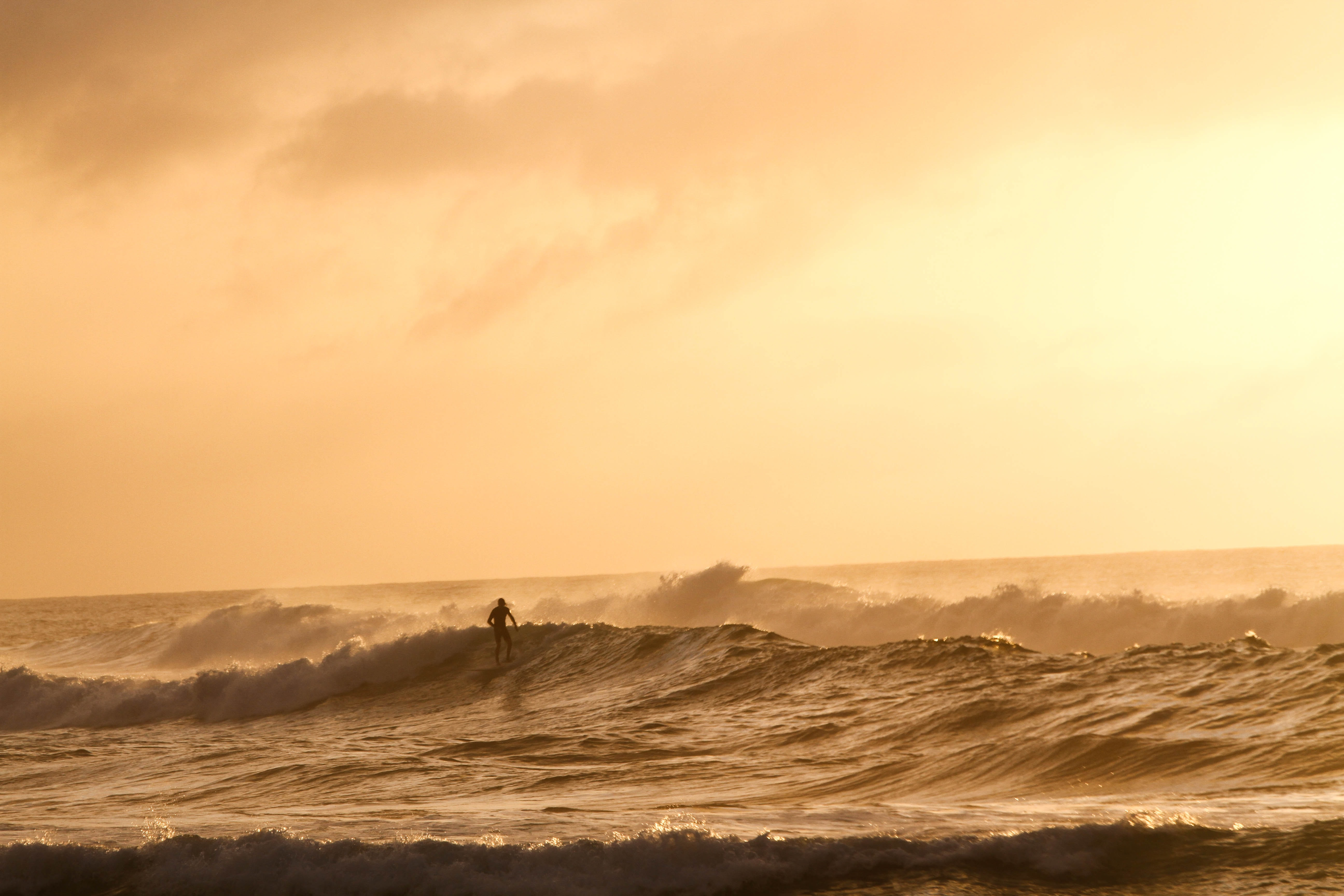 Large waves coming in during sunset.