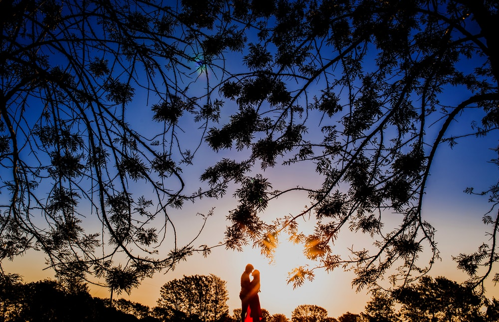 silhouette photo of man and woman hugging each other