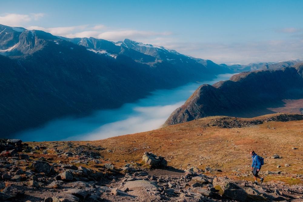 person walking on mountain