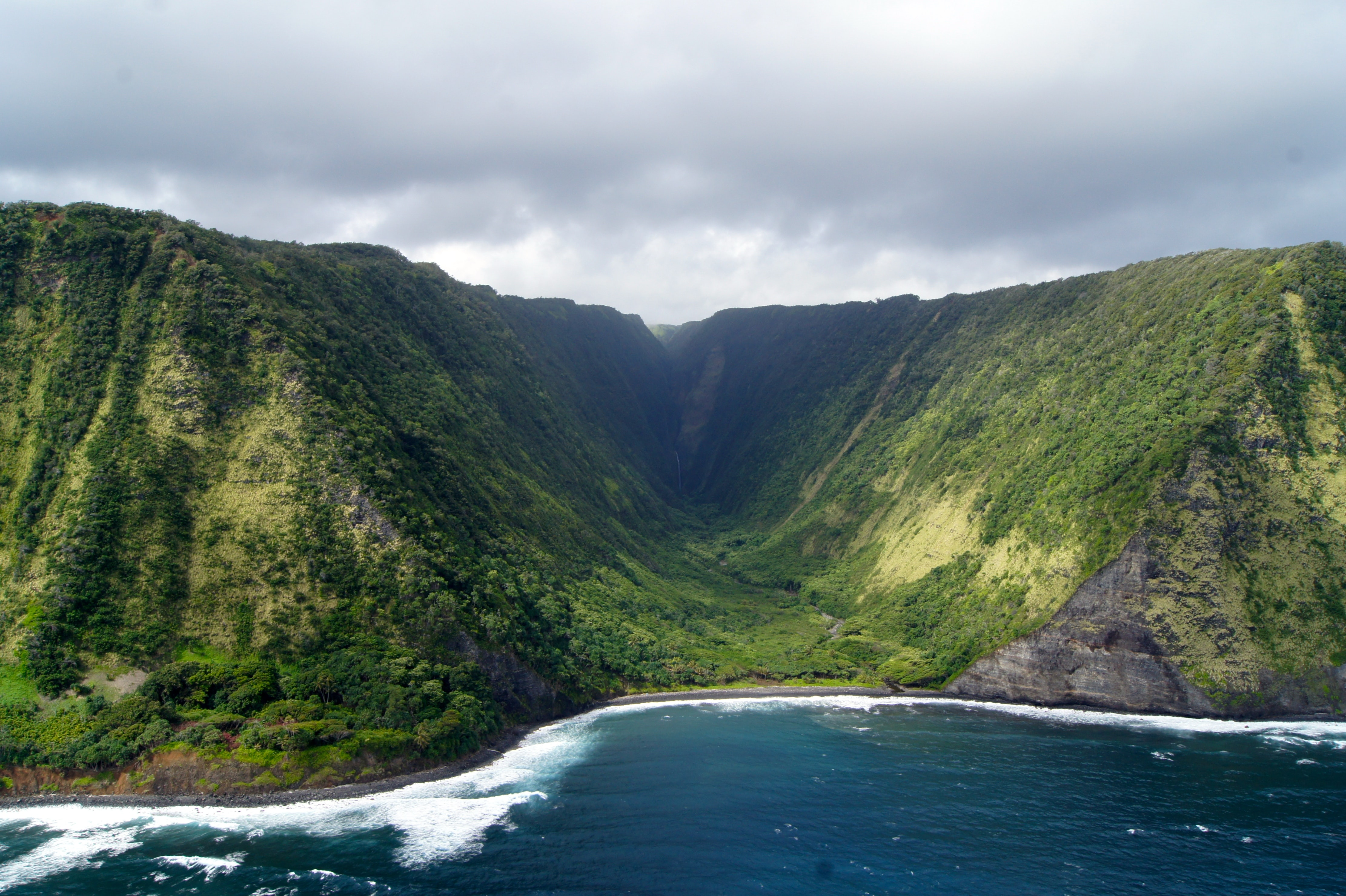 Green mountains valley at the coast of Island of Hawai'i