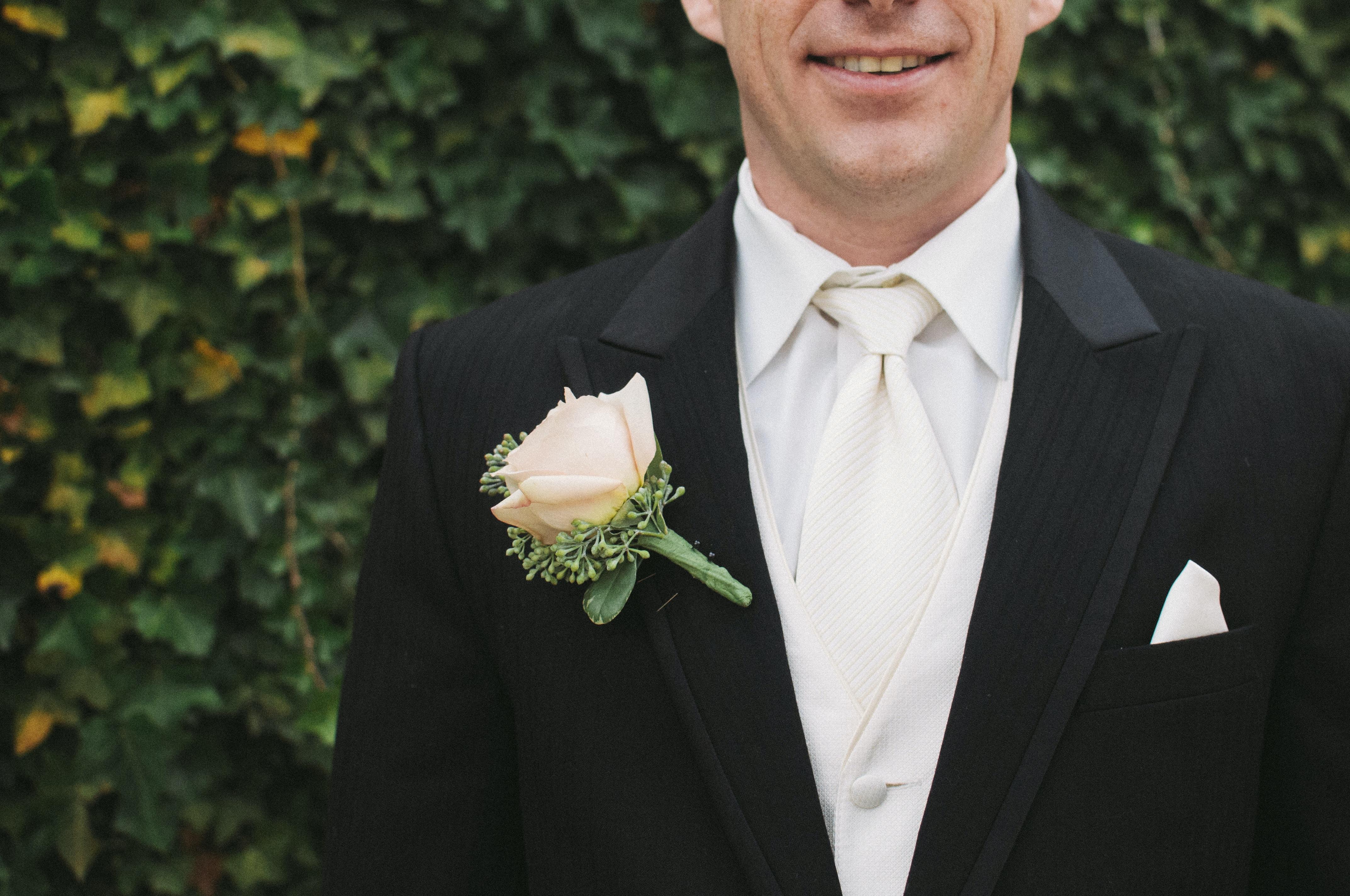 man wearing black suit jacket