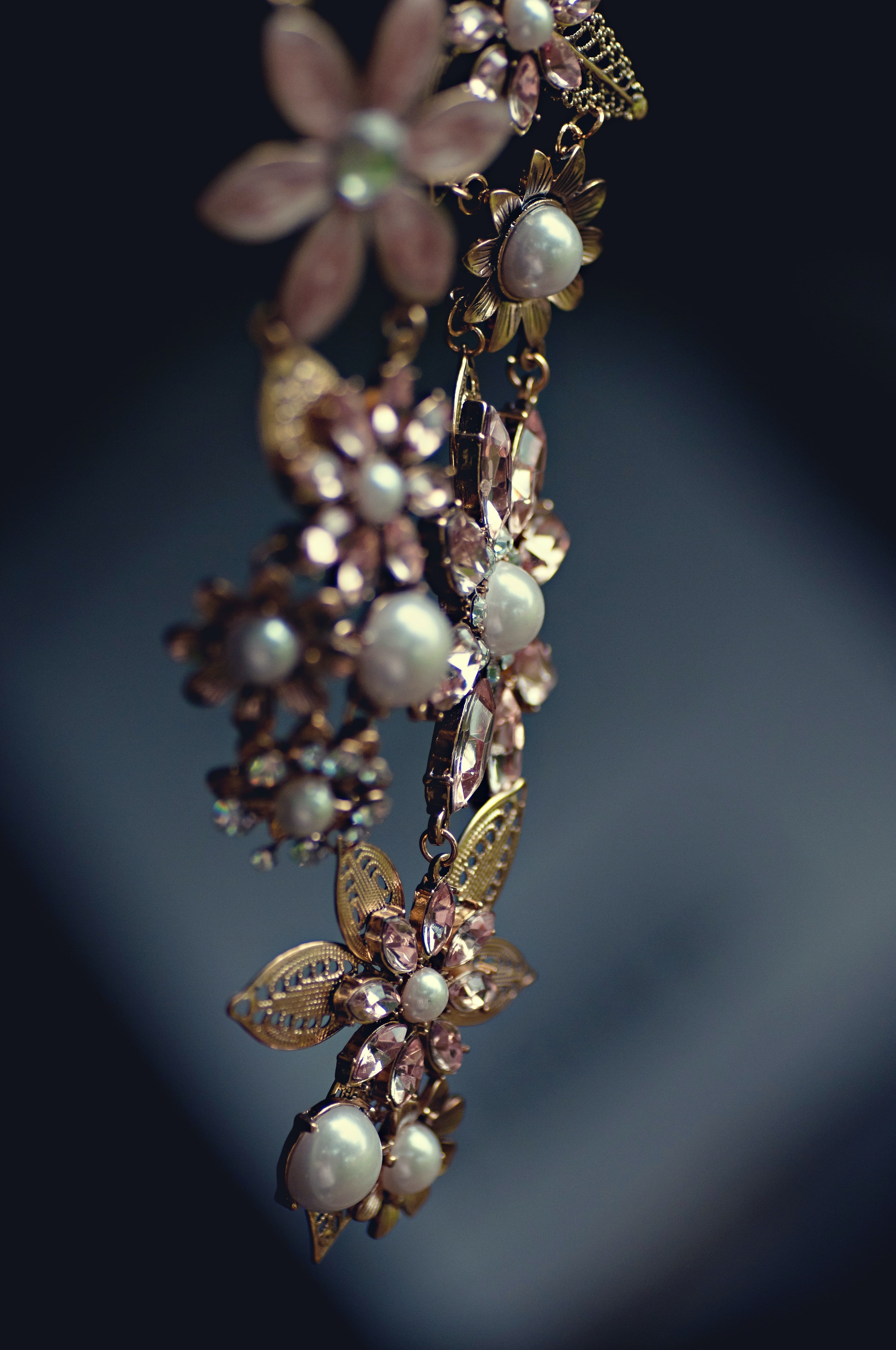 A piece of dangling pearl and flowers jewelry.