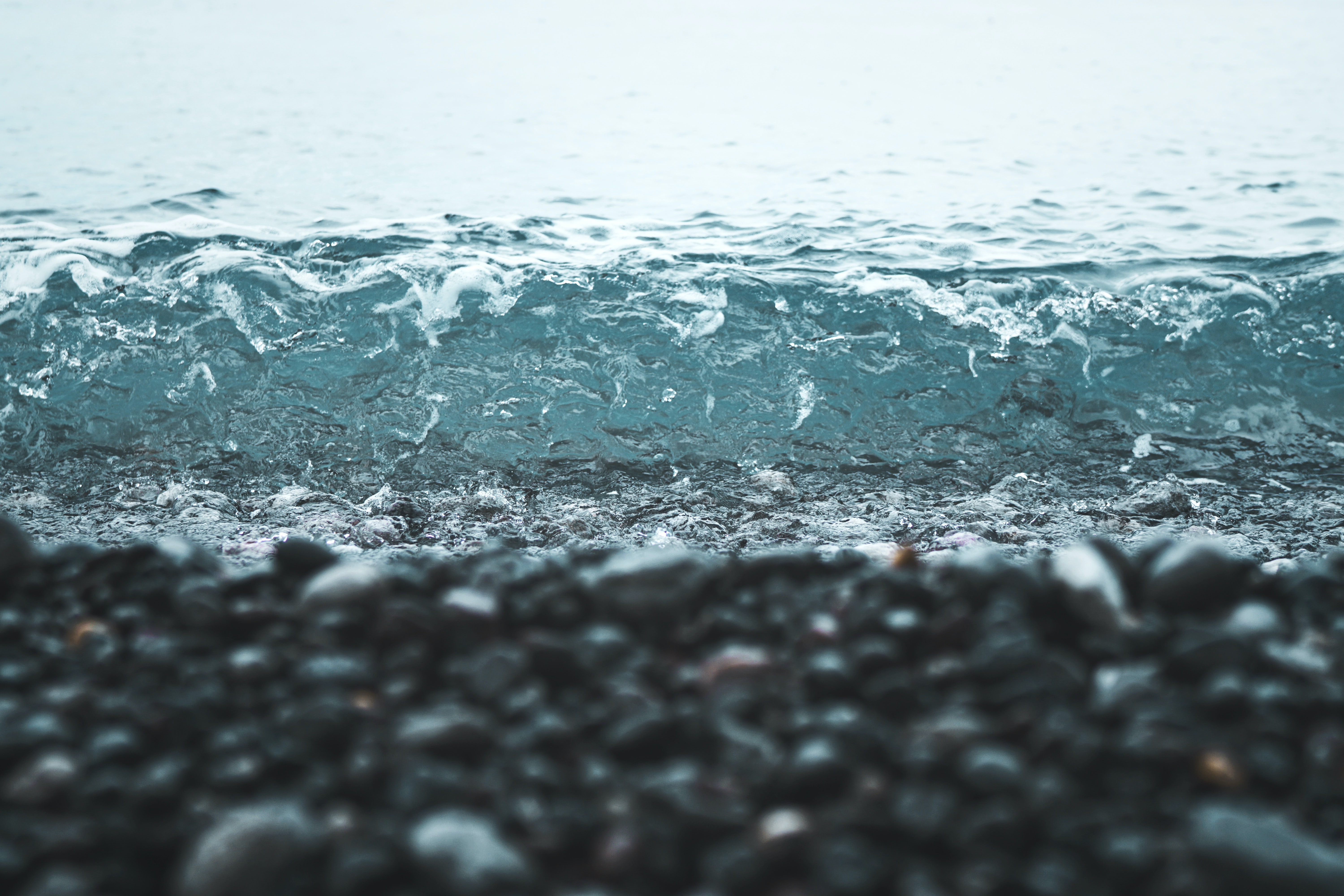 Small wave washing on a pebble beach