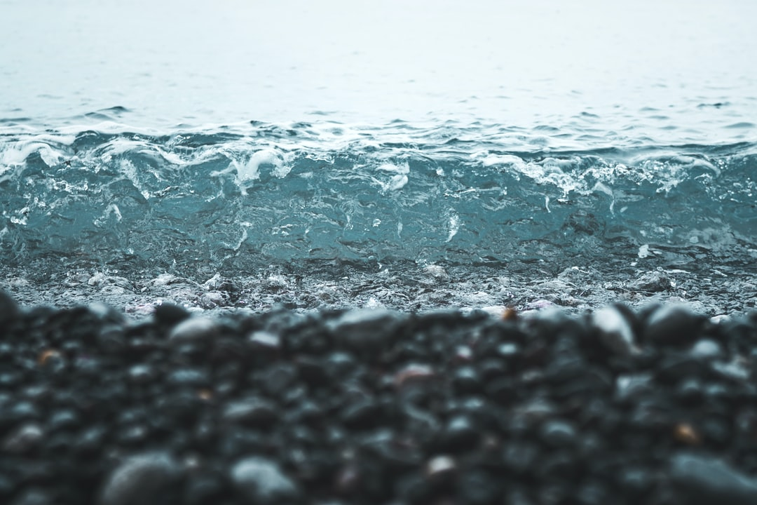 Wave washing on pebble beach