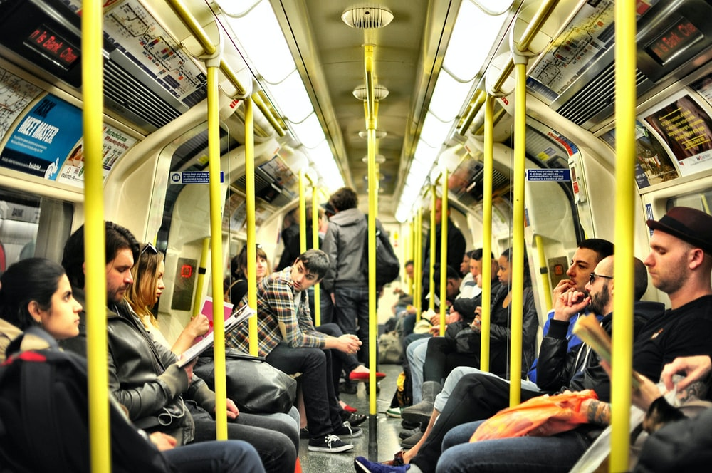 photo of group on people sitting inside train