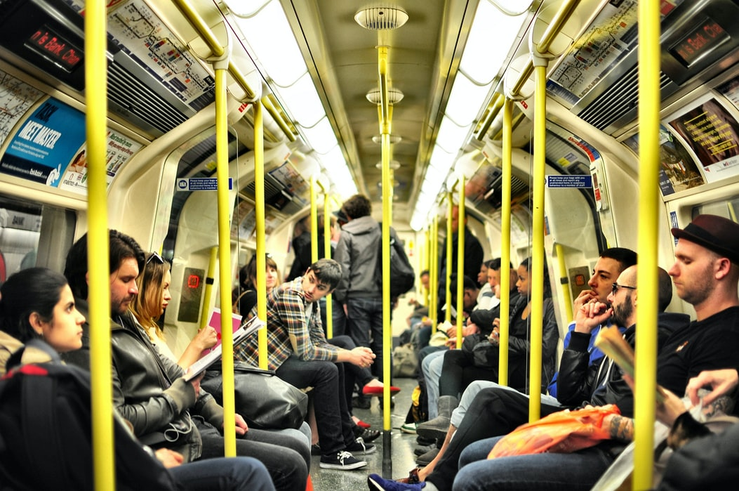 inside shot of a typically busy carriage on a london tube train