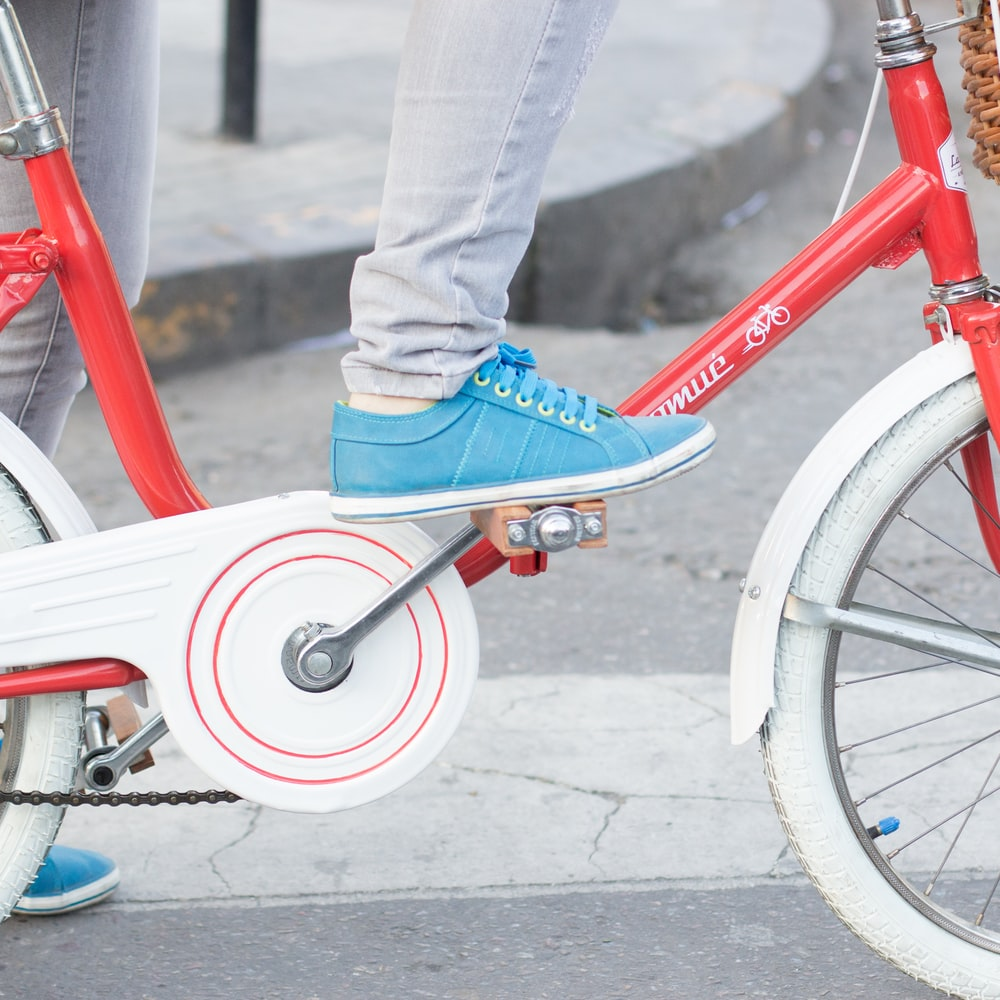 person riding red and white dutch bike