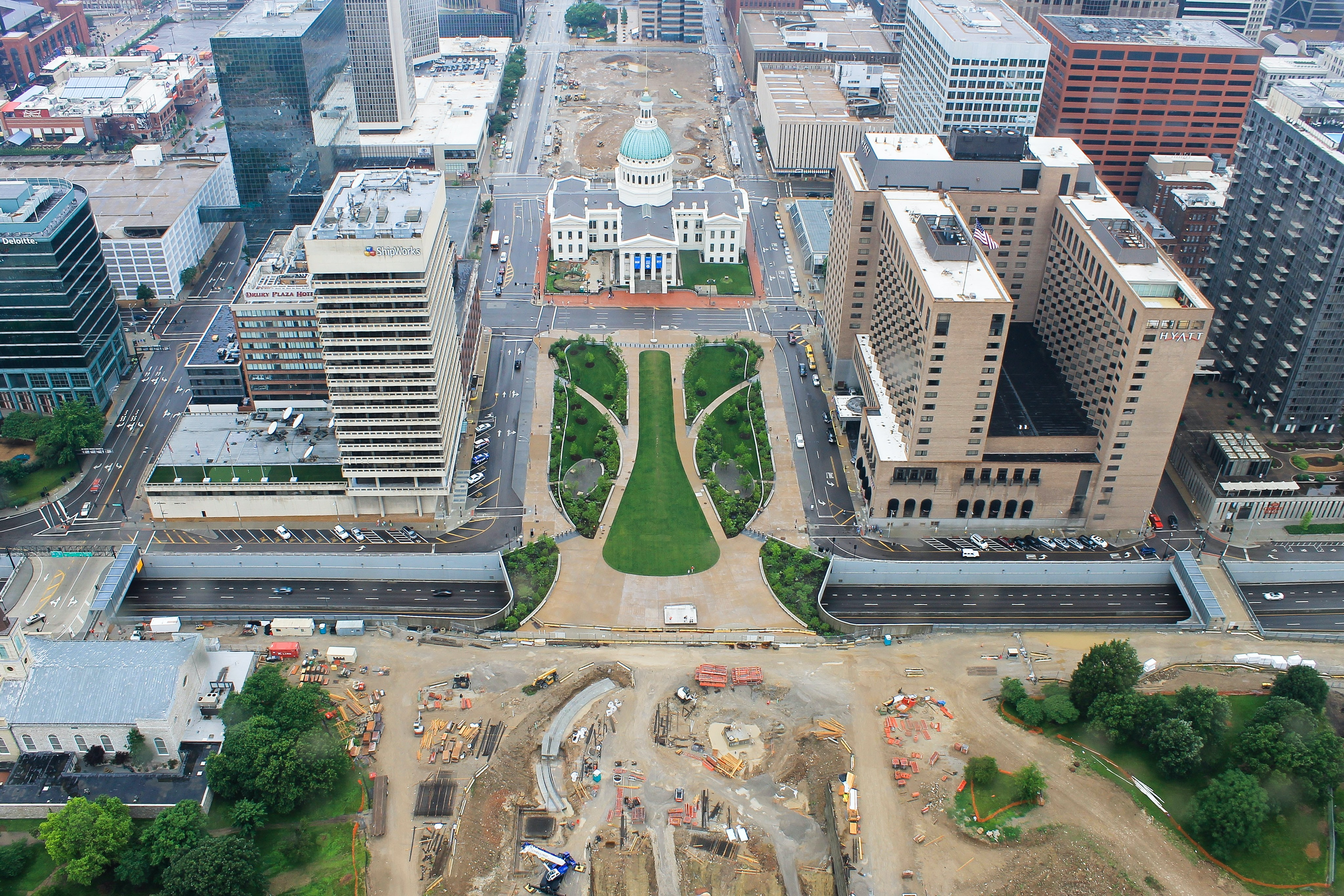 The view from above a construction site in St. Louis with surrounding buildings and city hall.