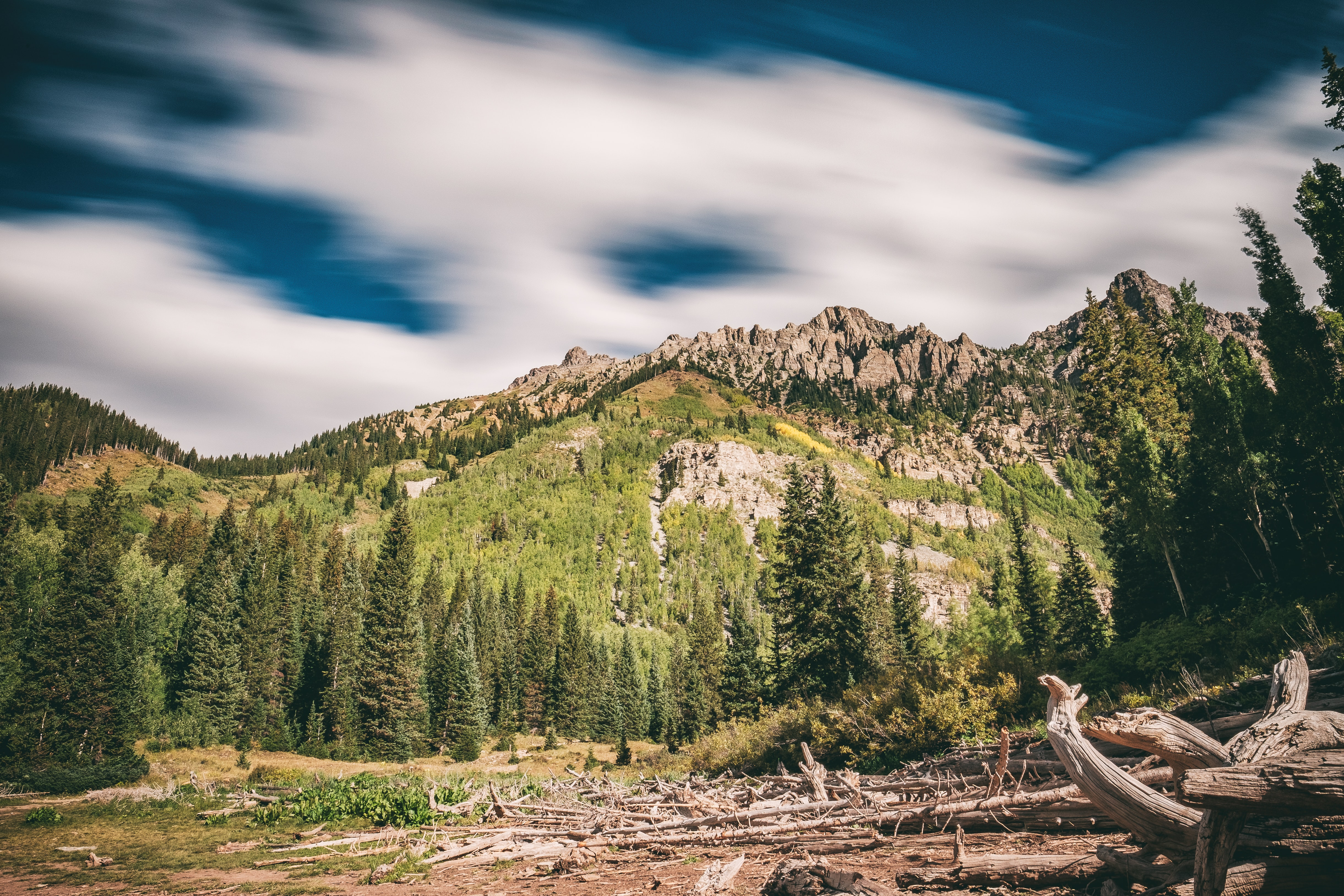 landscape photography of green mountain under clear sky