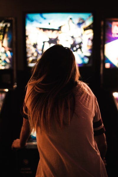 woman playing arcade