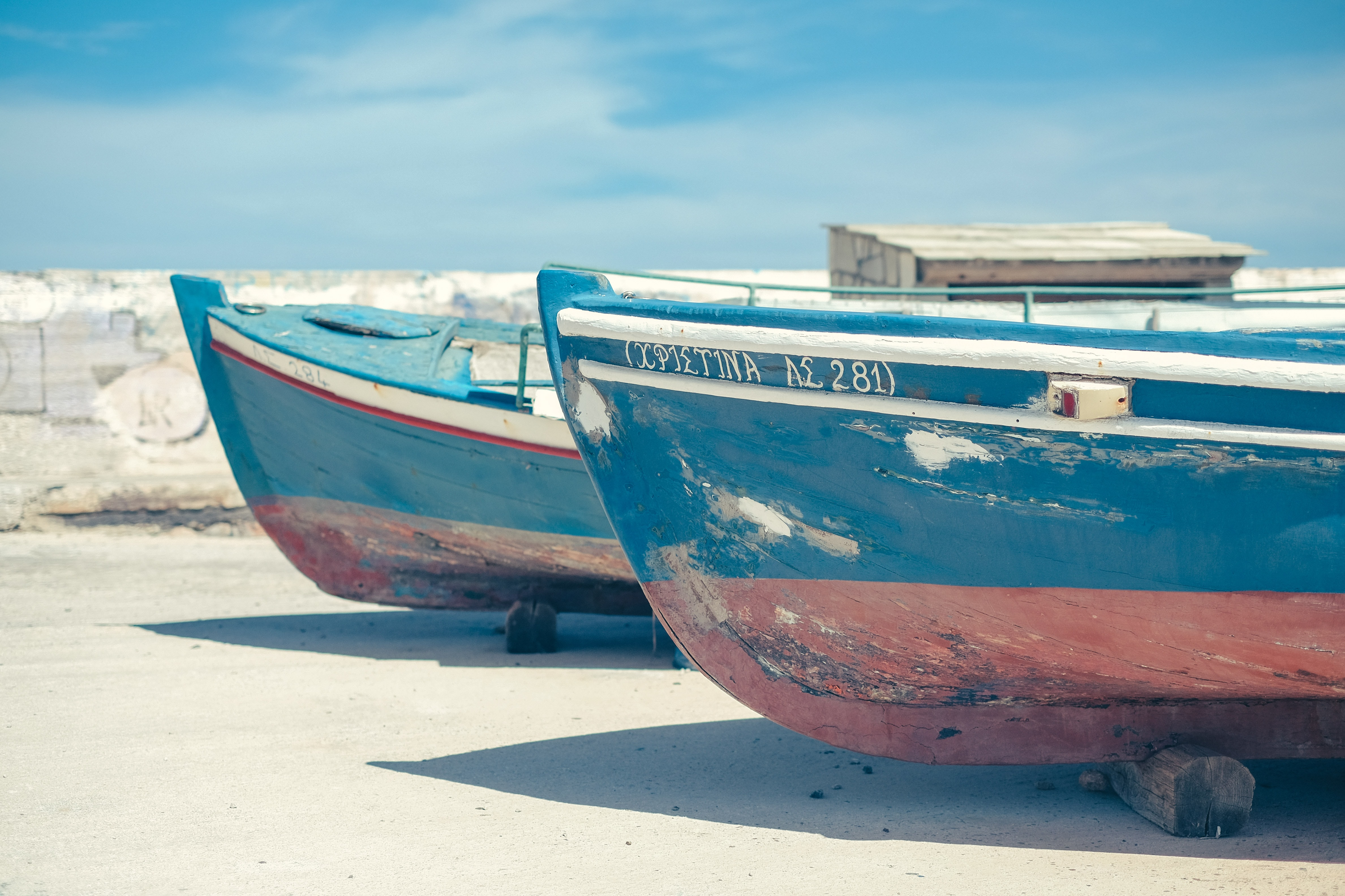 two blue-and-brown boat beside each other