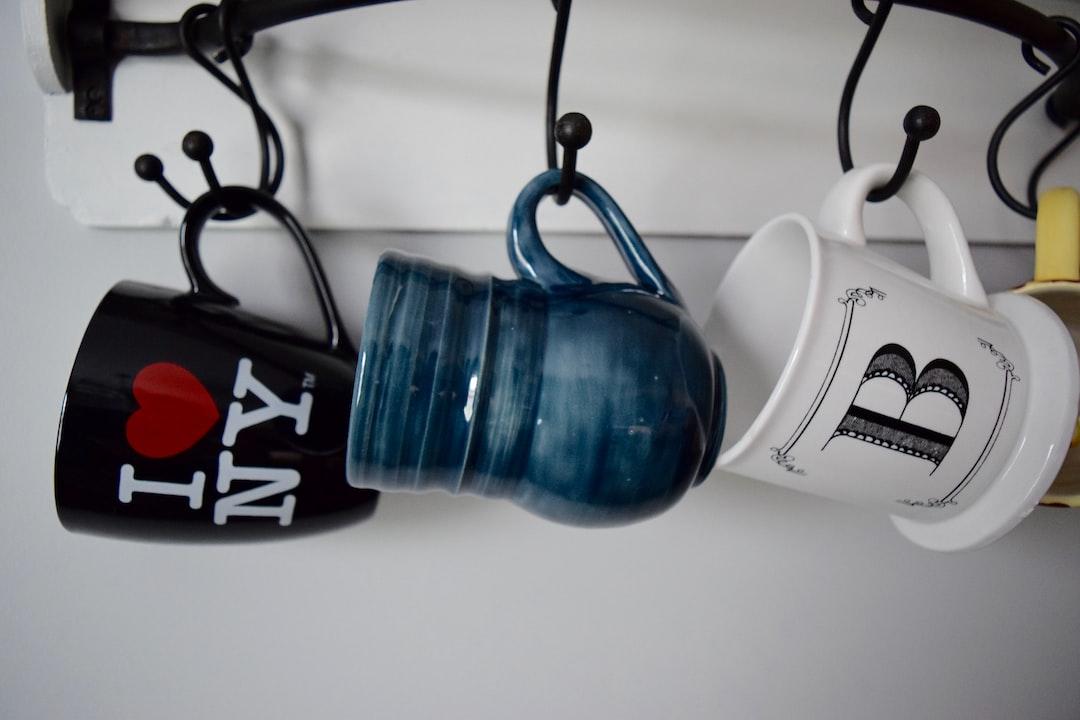 Three mugs on a rack