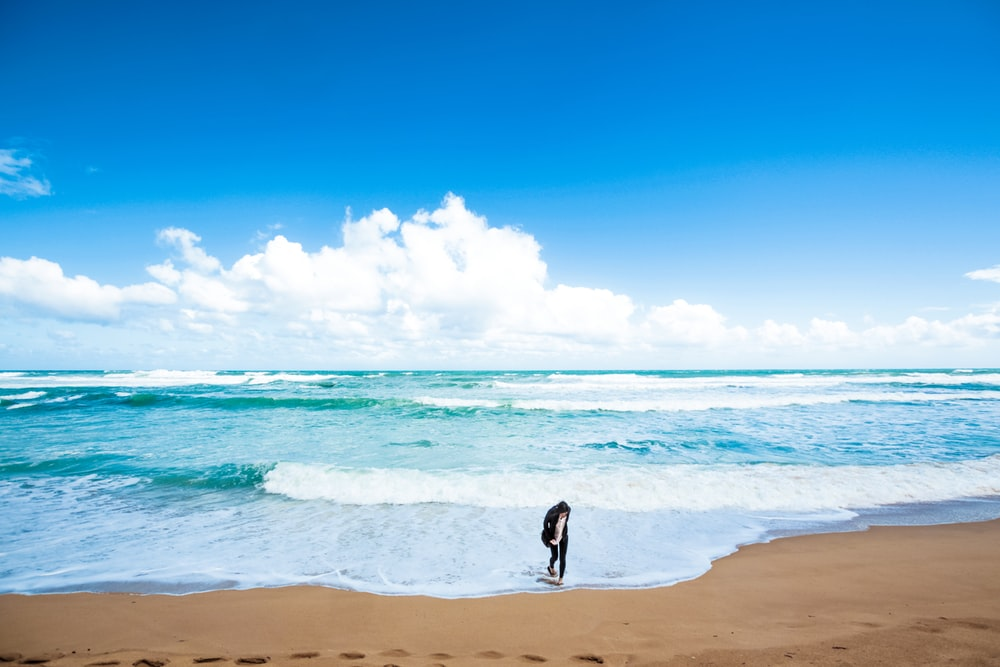person standing near shore