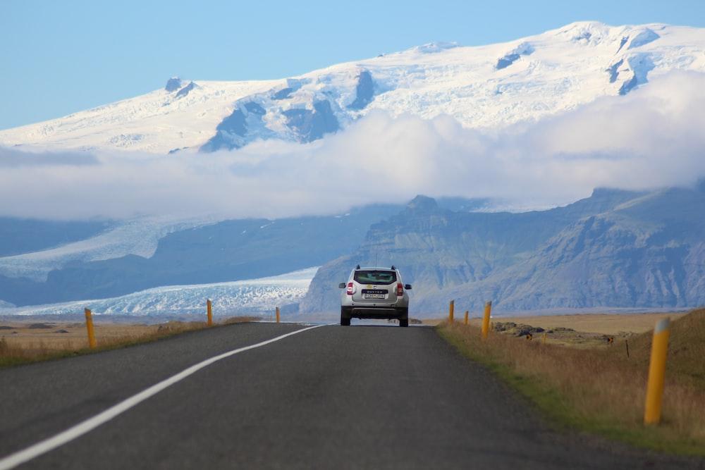 white SUV passing through roadway