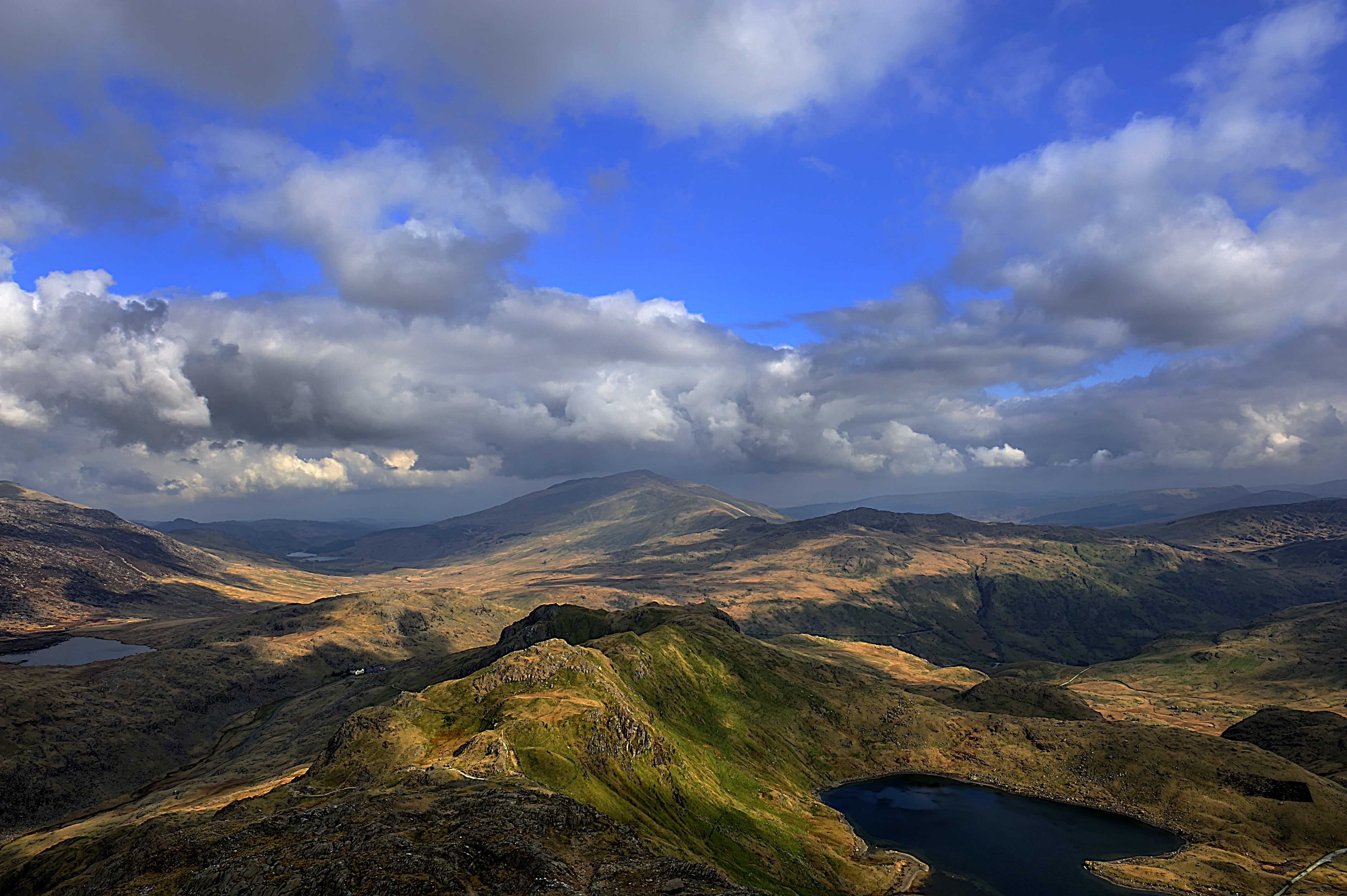 Gray clouds gathering over a mountainous landscape in Snowdonia National Park