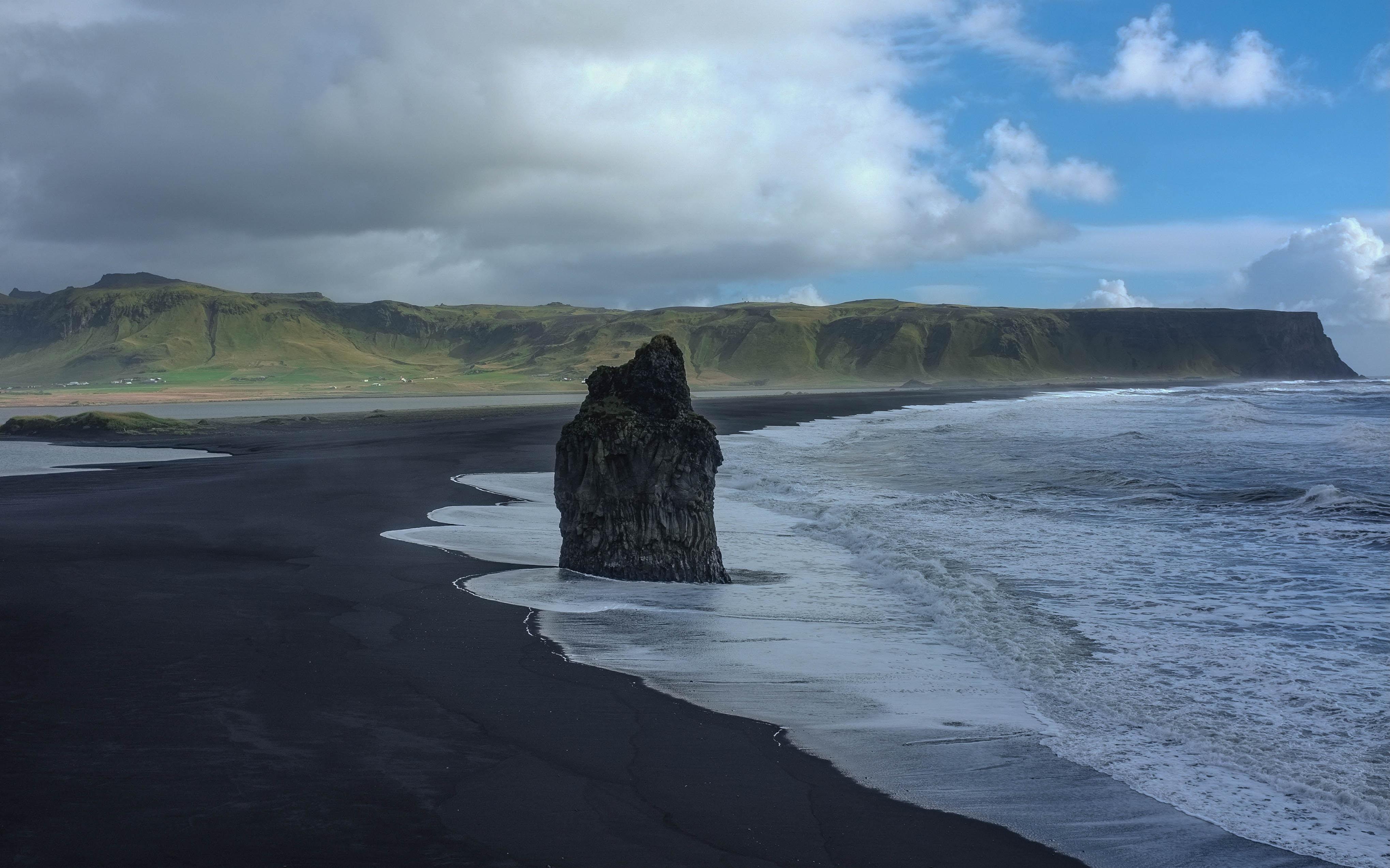 Large rock on the black sand beach in Reynisfjara