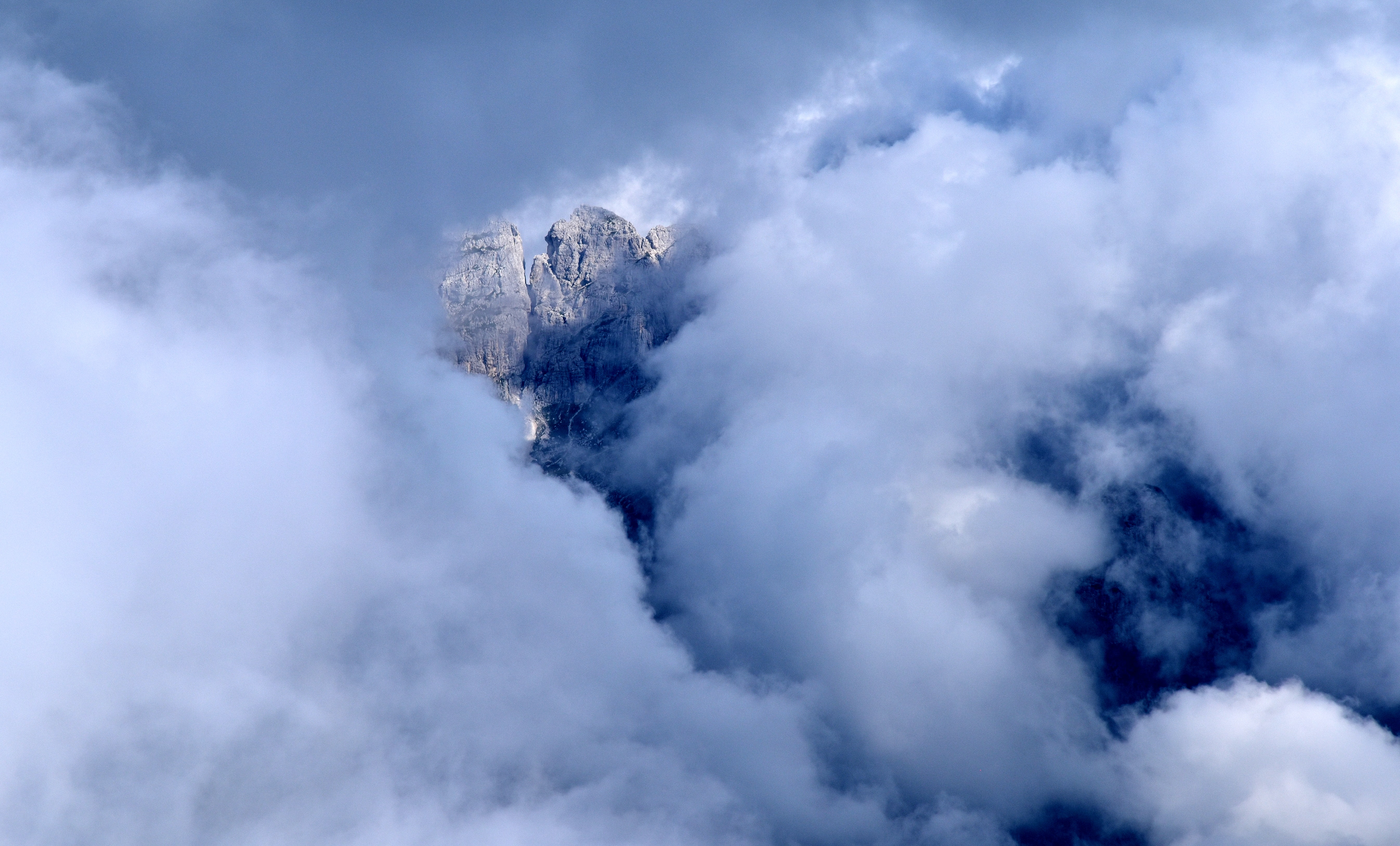 rock formation covered with clouds