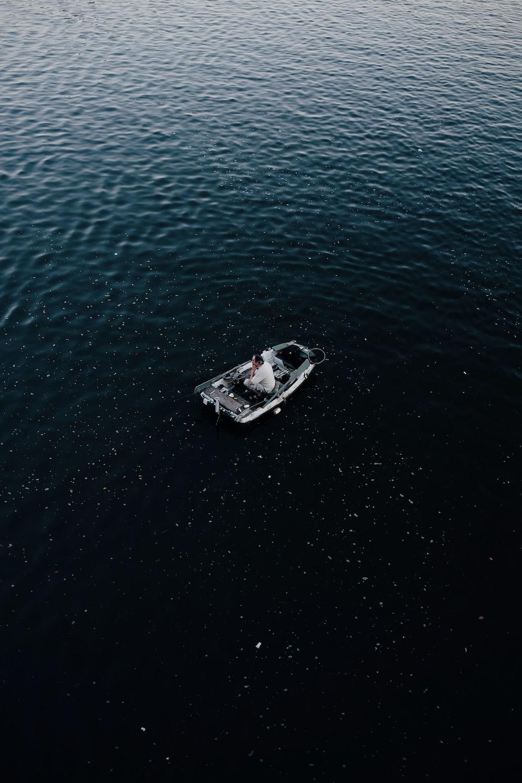 man in gray canoe boat