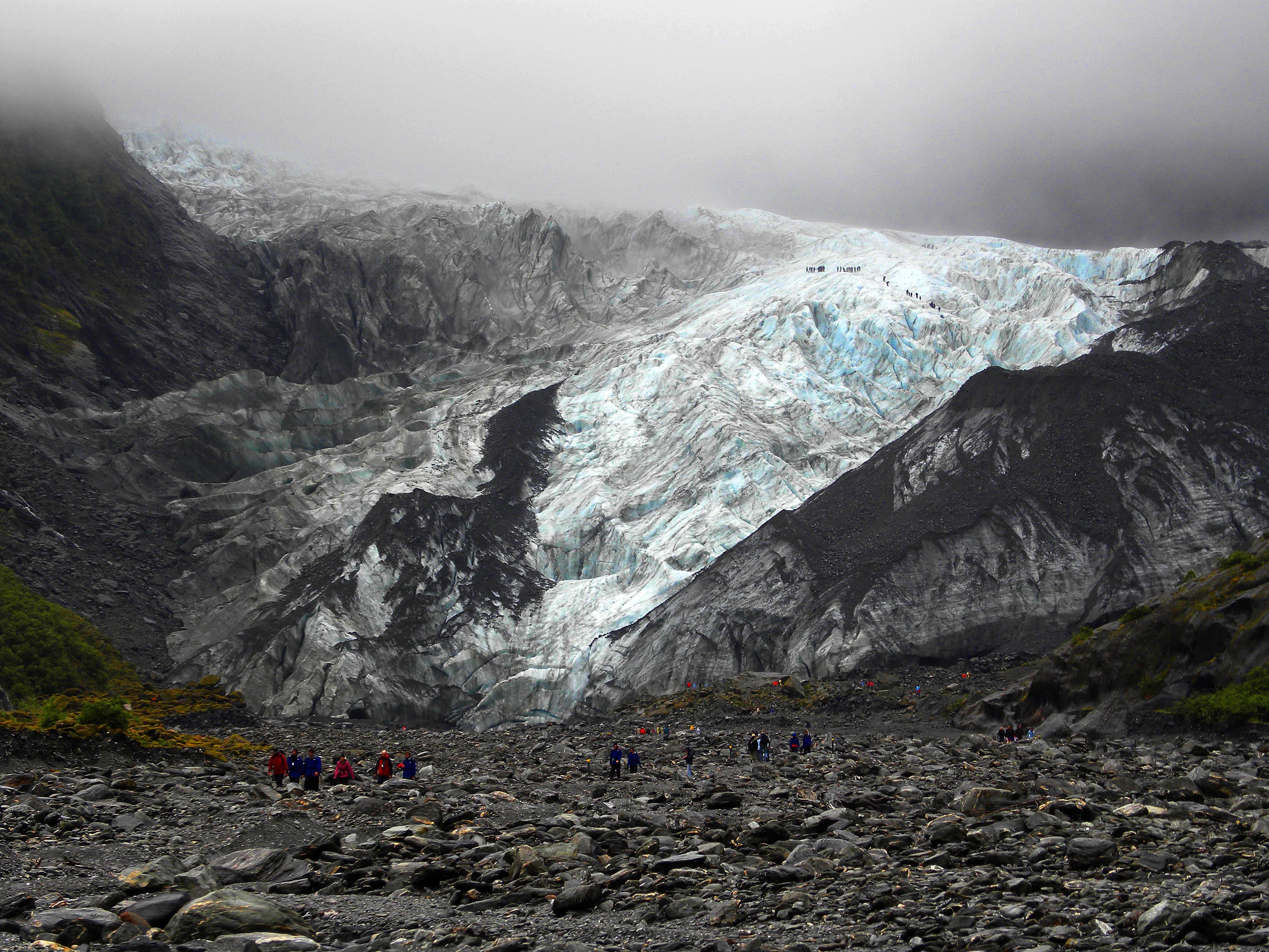 people walking near mountain