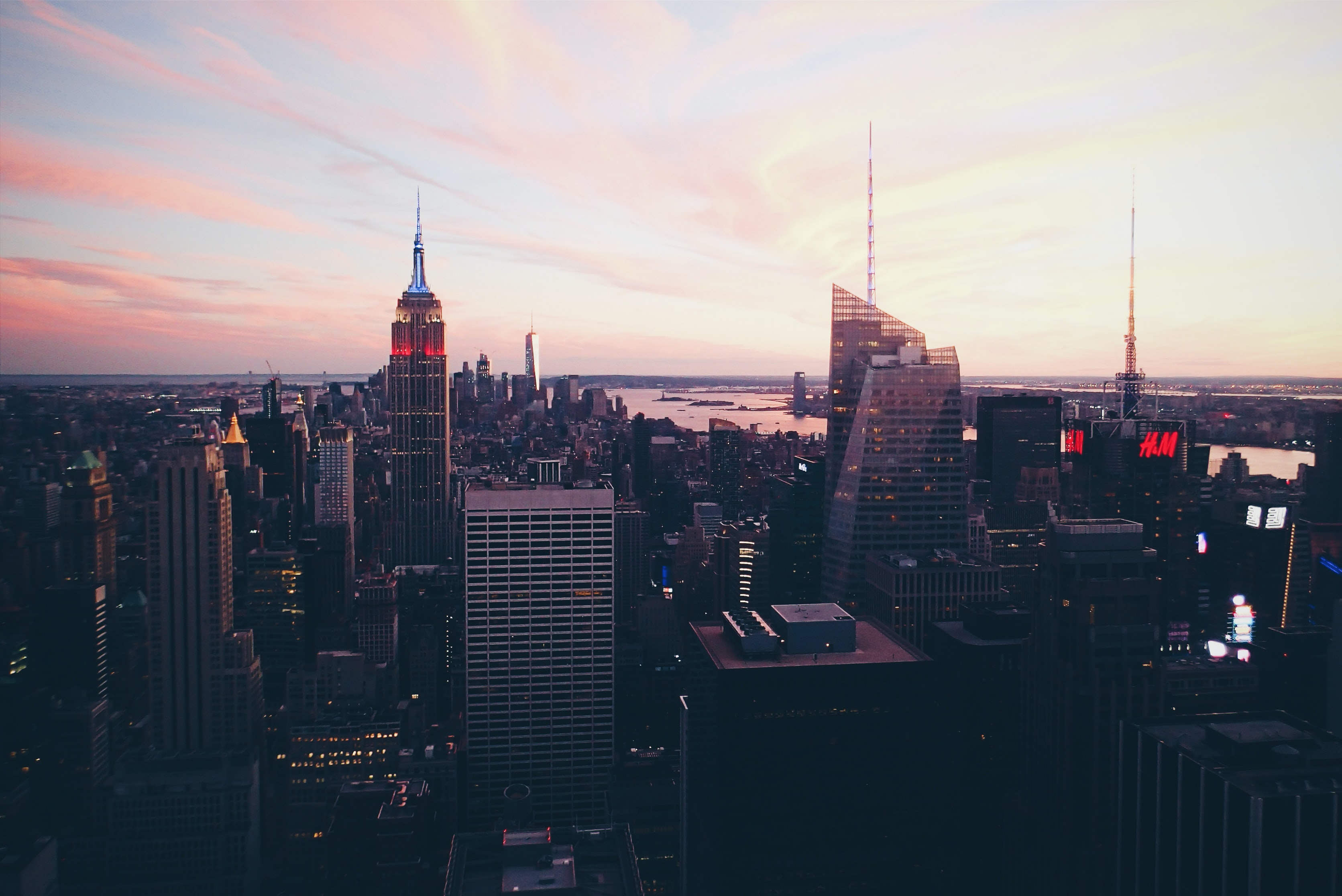 A panoramic view of New York City skyscrapers during sunset.