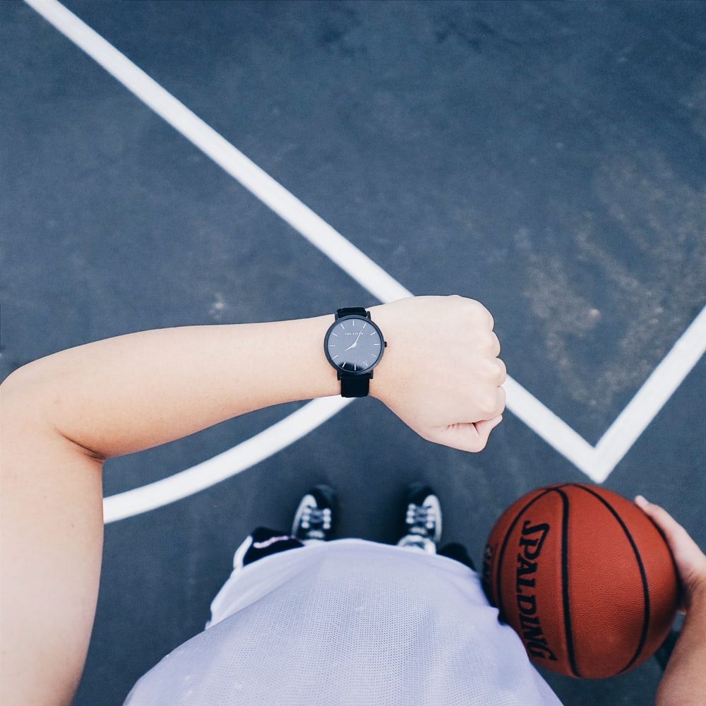 person wearing black analog watch